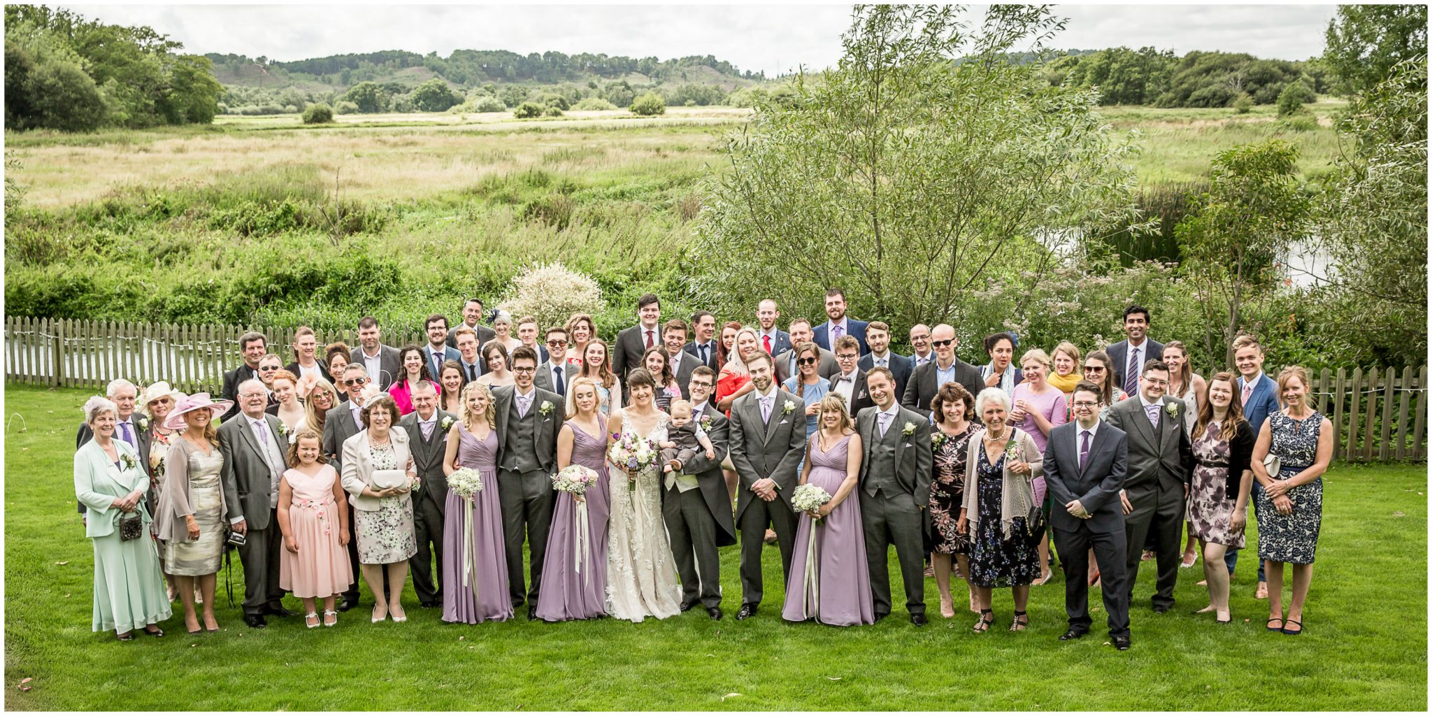 Sopley Mill wedding photography groiup phot with water meadows in background