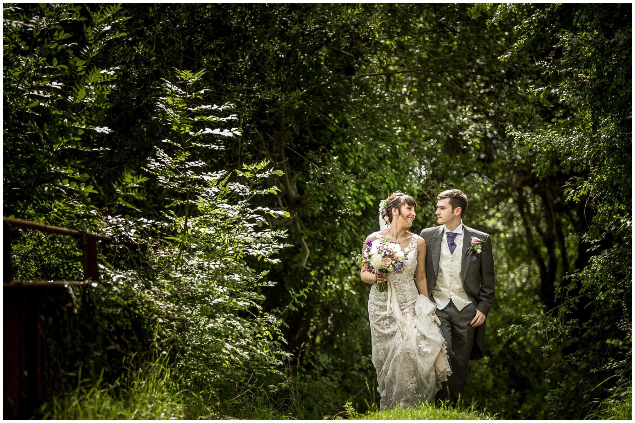 Sopley Mill wedding photography couple walk over bridge