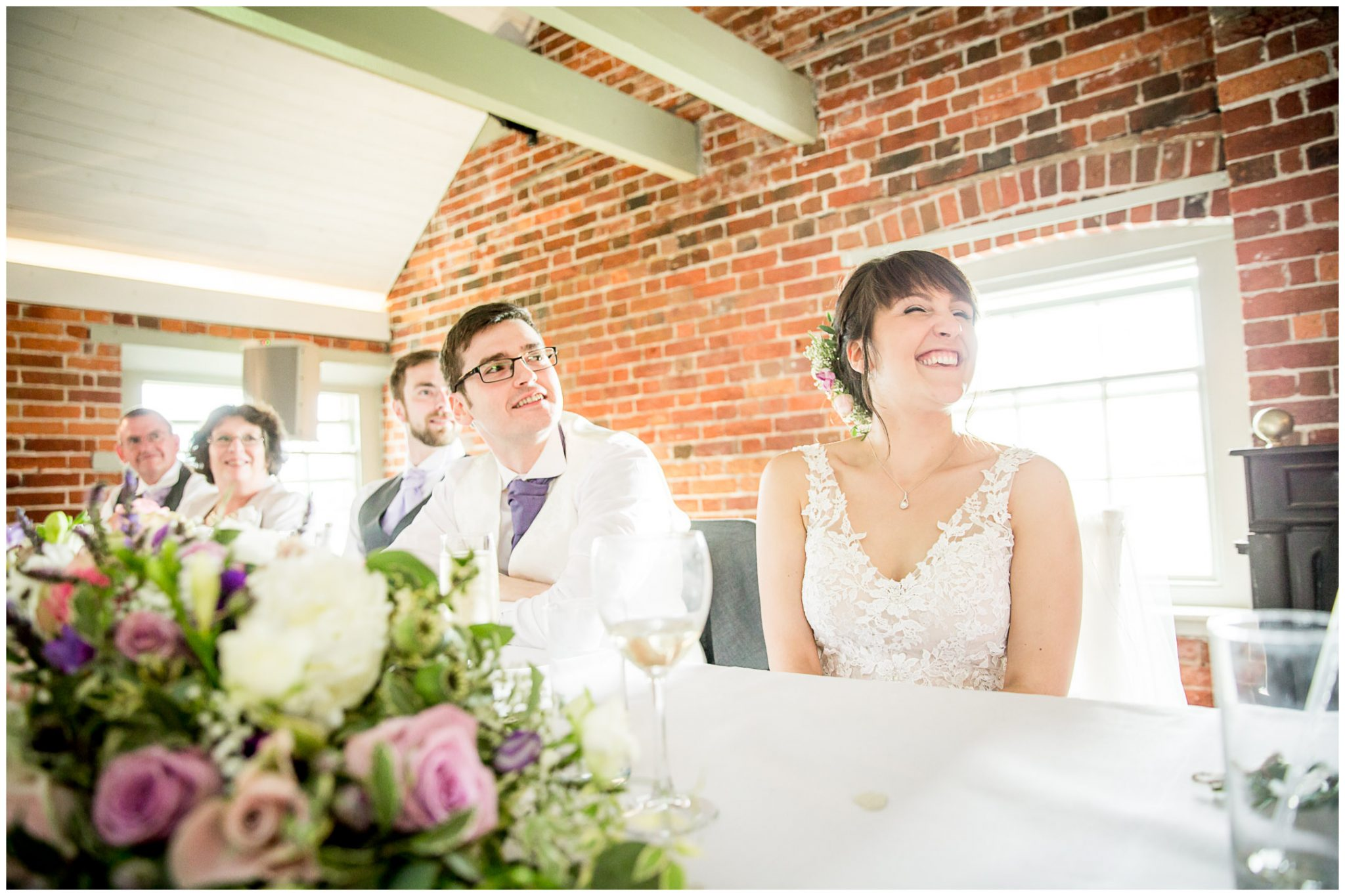 Sopley Mill wedding photography bride laughing at wedding speech