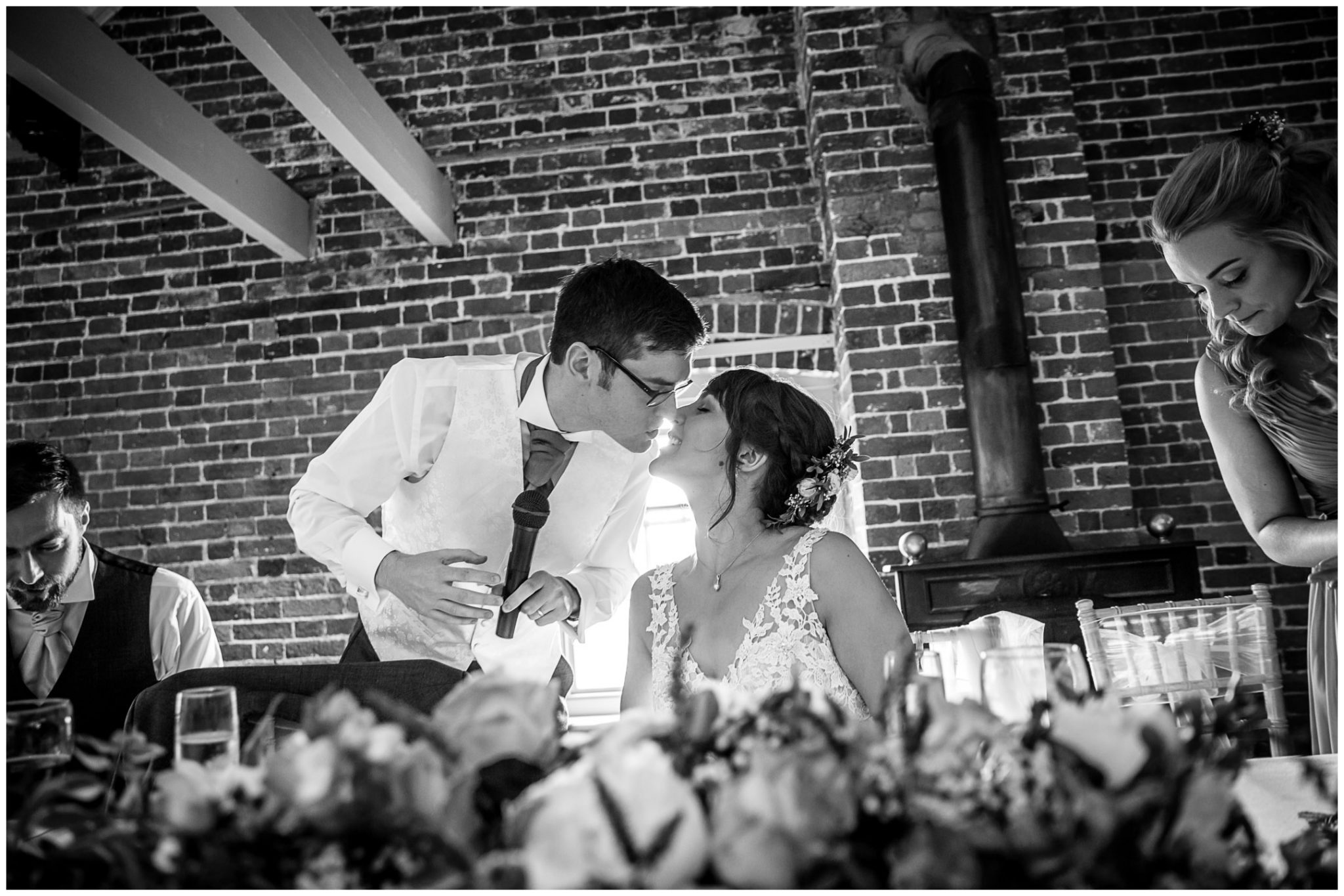 Sopley Mill wedding photography couple kiss at end of groom's speech