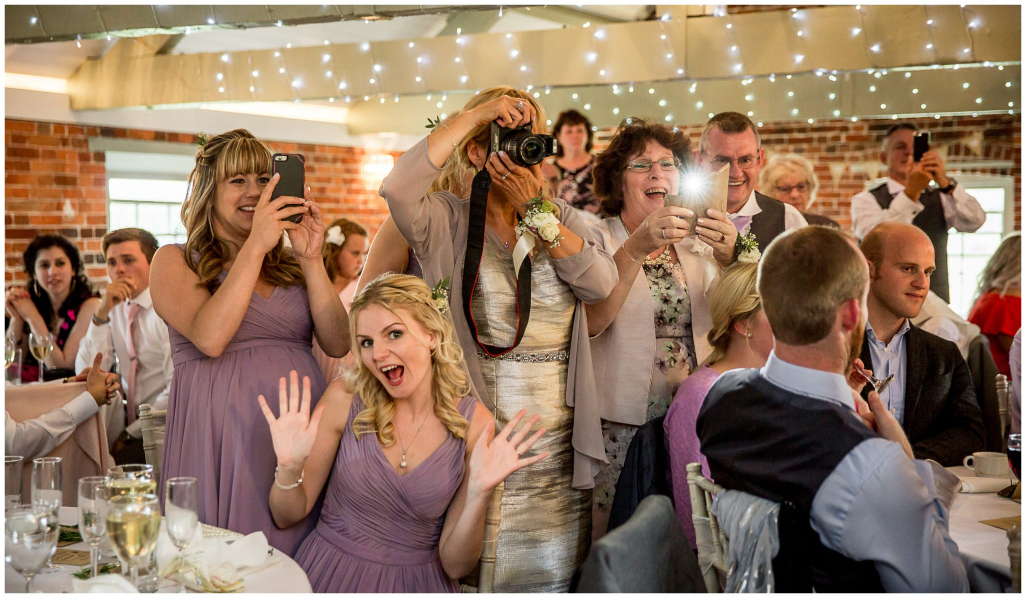 Sopley Mill wedding photography watching the cake cutting