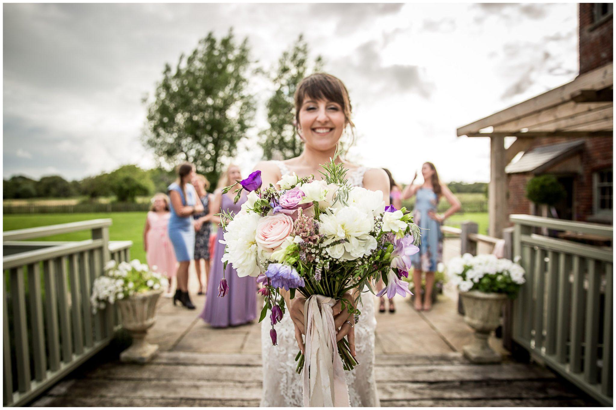 Sopley Mill wedding photography bride prepares to throw bouquet
