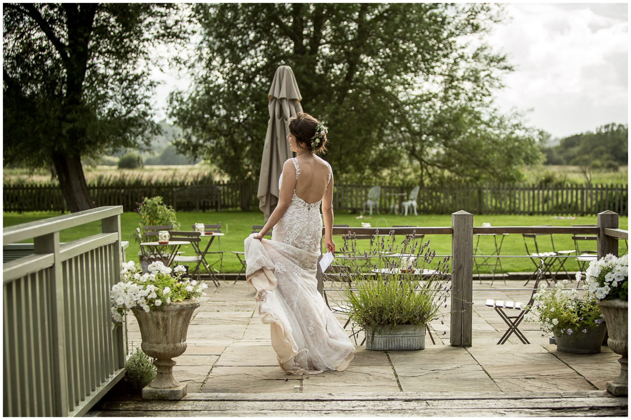 Sopley Mill wedding photography bride walks across bridge