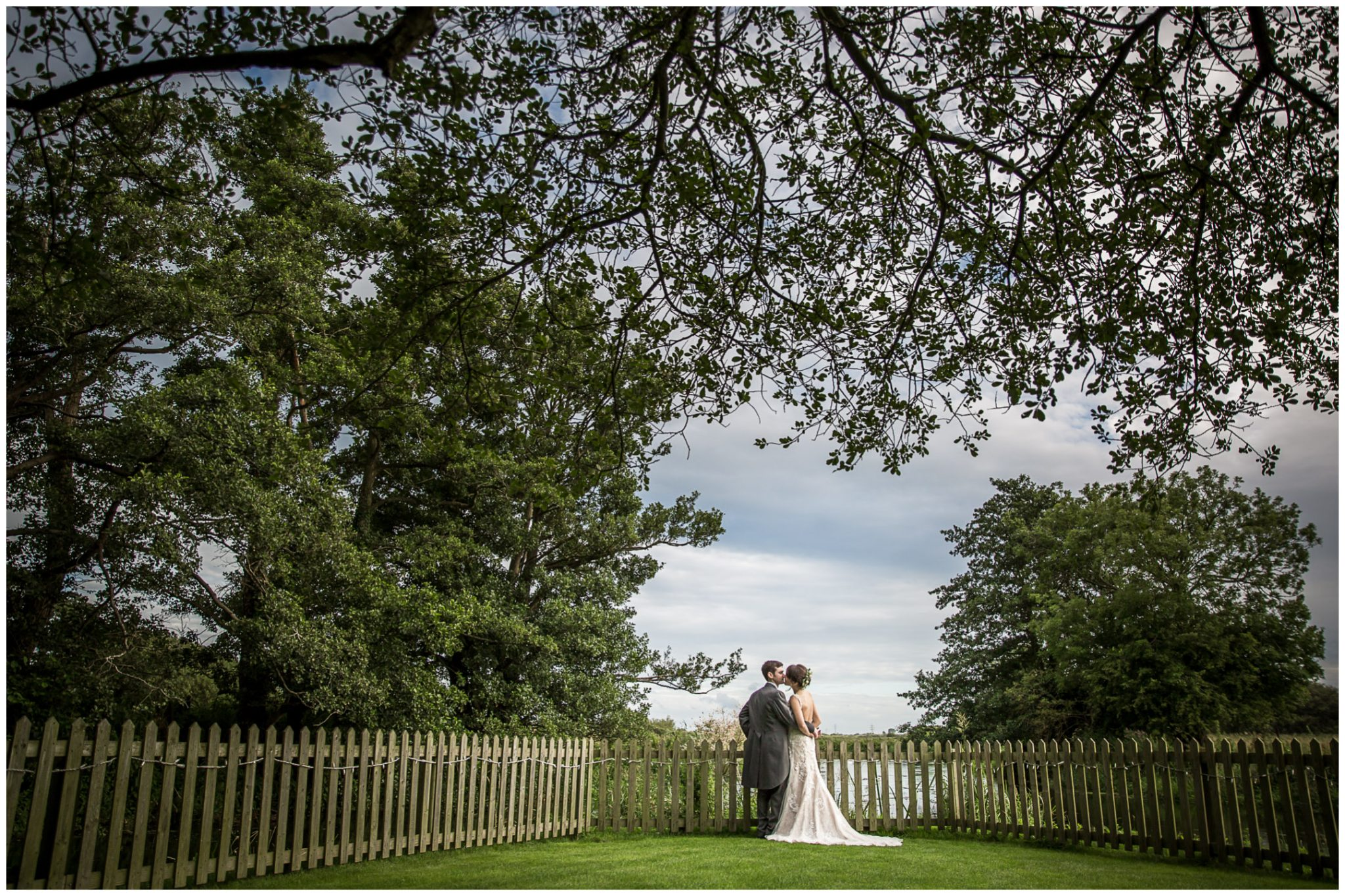 Sopley Mill wedding photography couple stood at far end of gardens