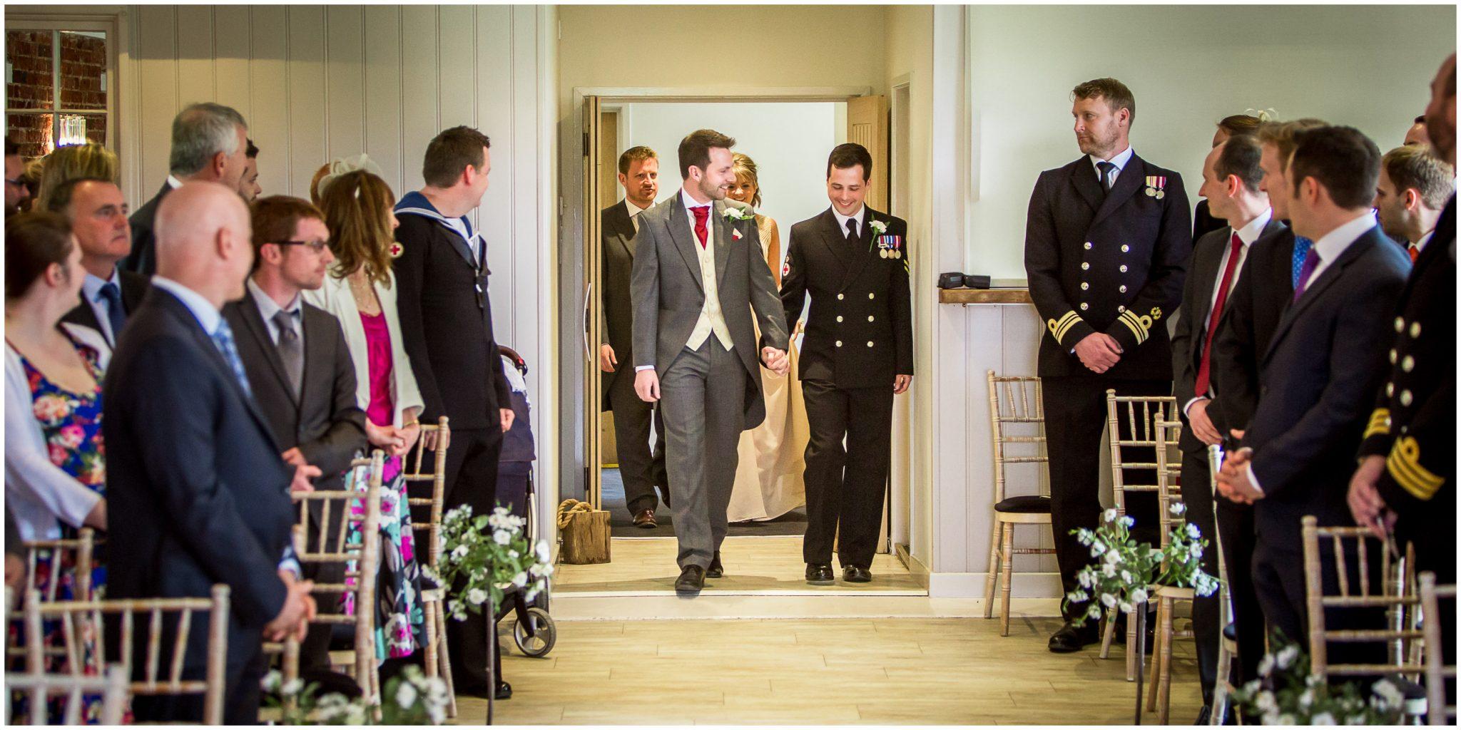 Sopley wedding photographer grooms walk down aisle