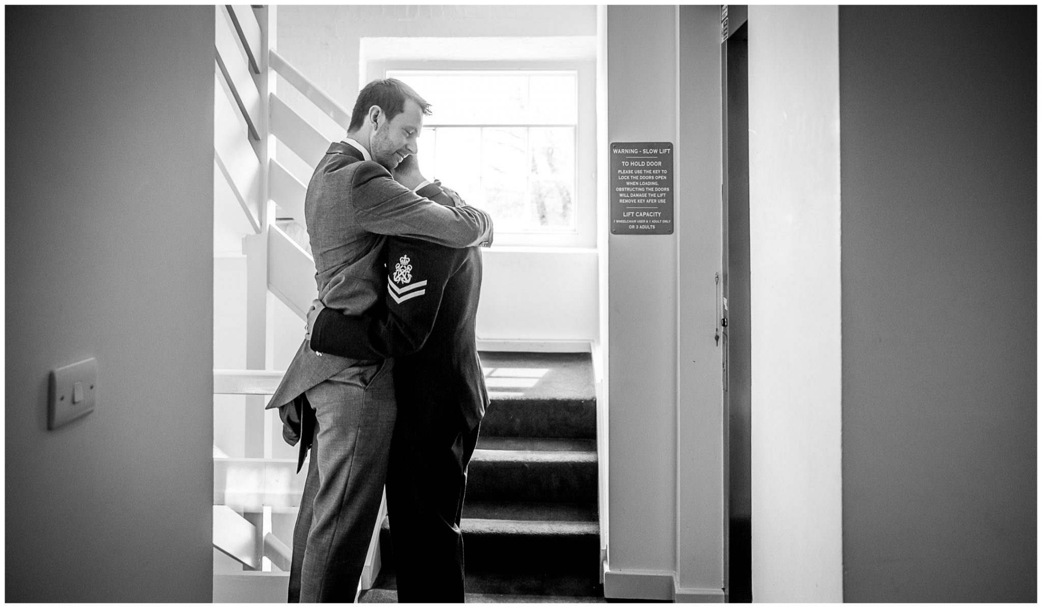 Sopley wedding photographer grooms take a moment outside ceremony room