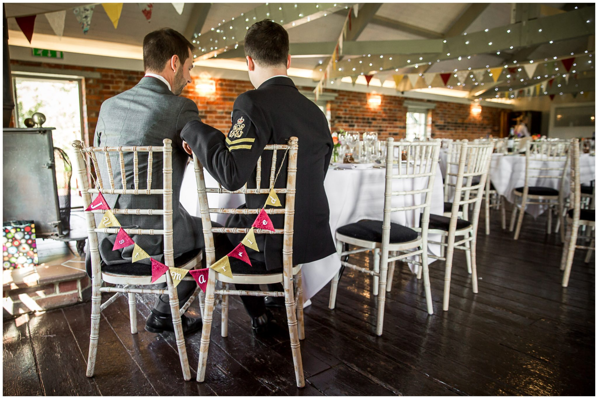 Sopley wedding photographer grooms in dining room