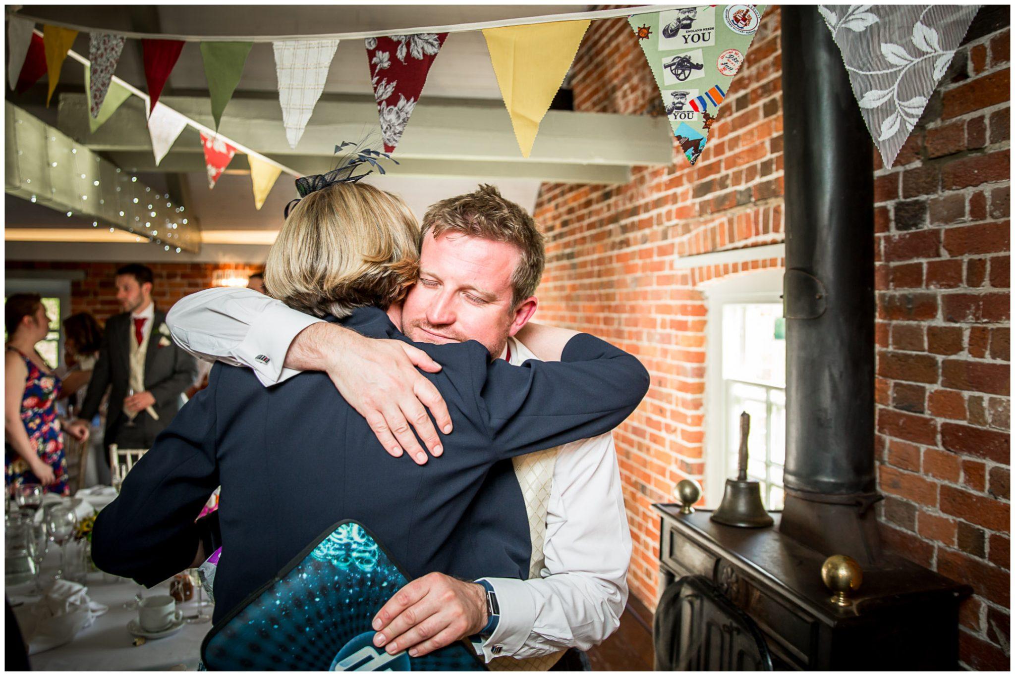 Sopley wedding photographer best man hug
