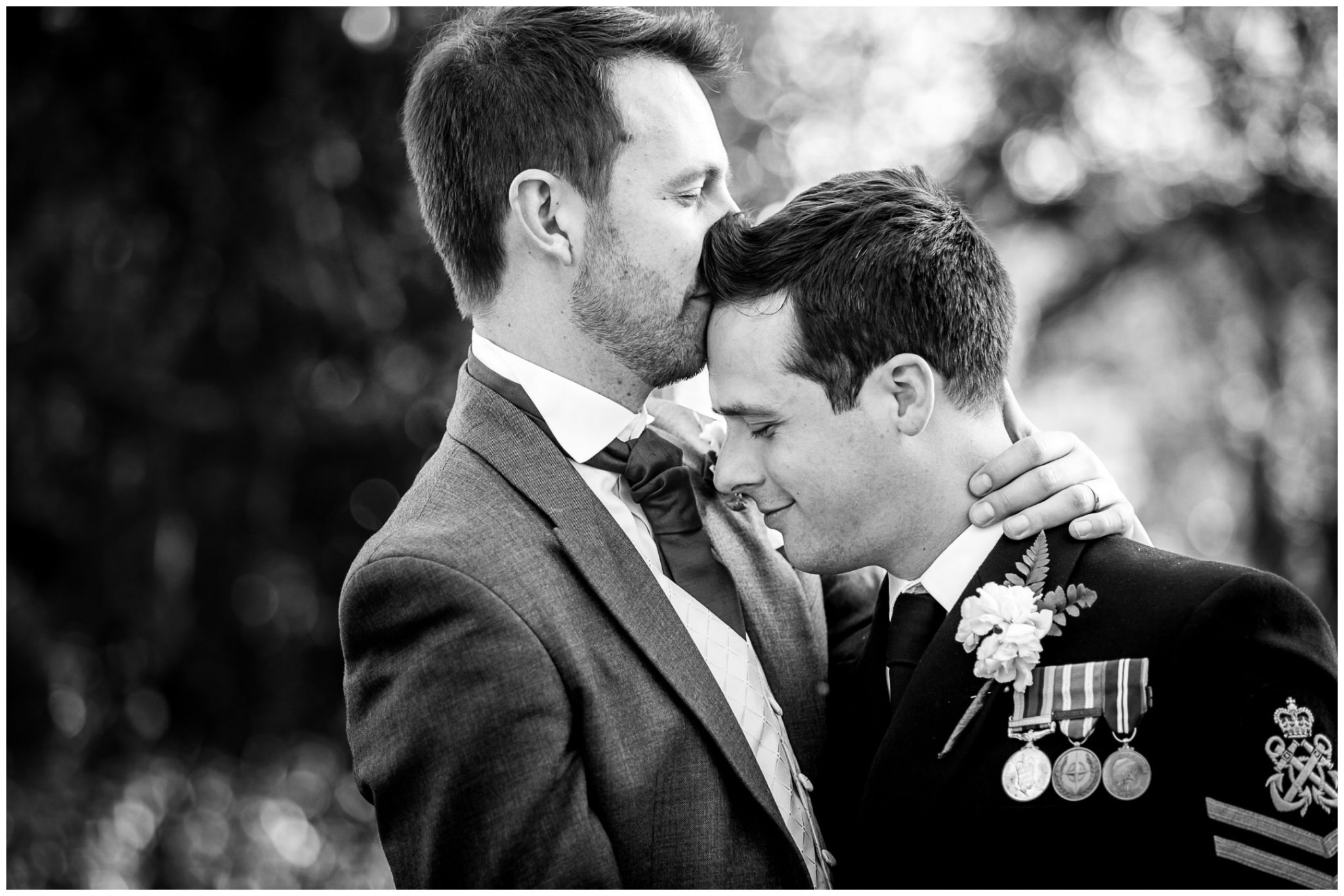 Sopley wedding photographer couple kiss black and white
