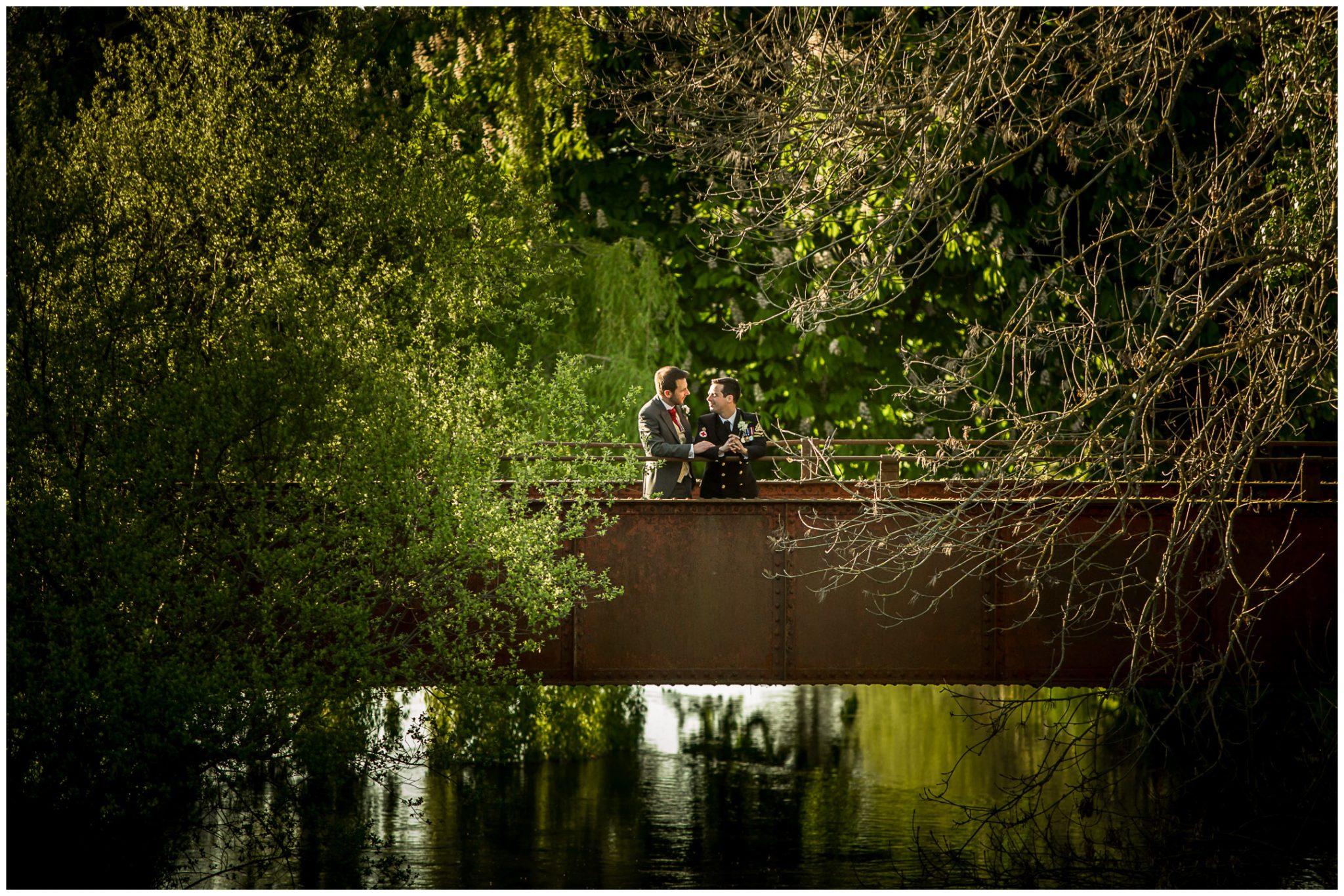 Sopley wedding photographer couple on iron bridge