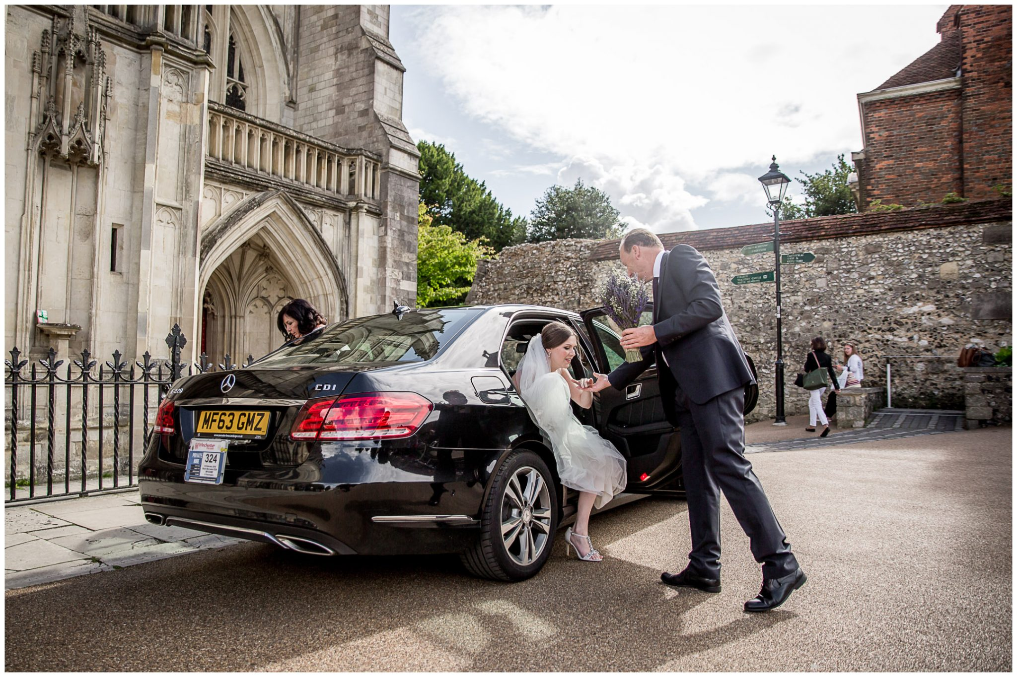 winchester cathedral wedding photography bride steps out of wedding car