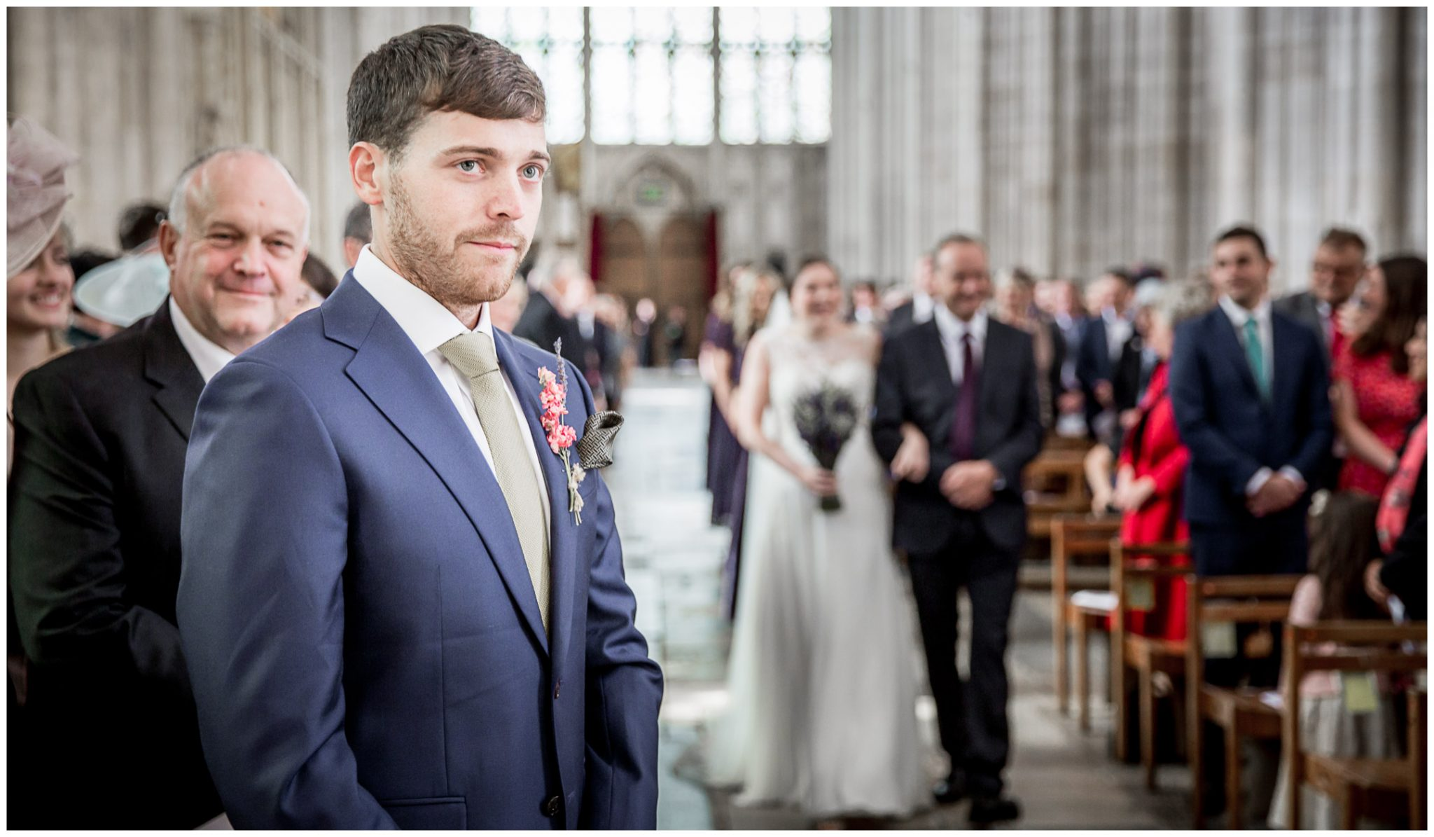winchester cathedral wedding photography groom waits for bride to arrive