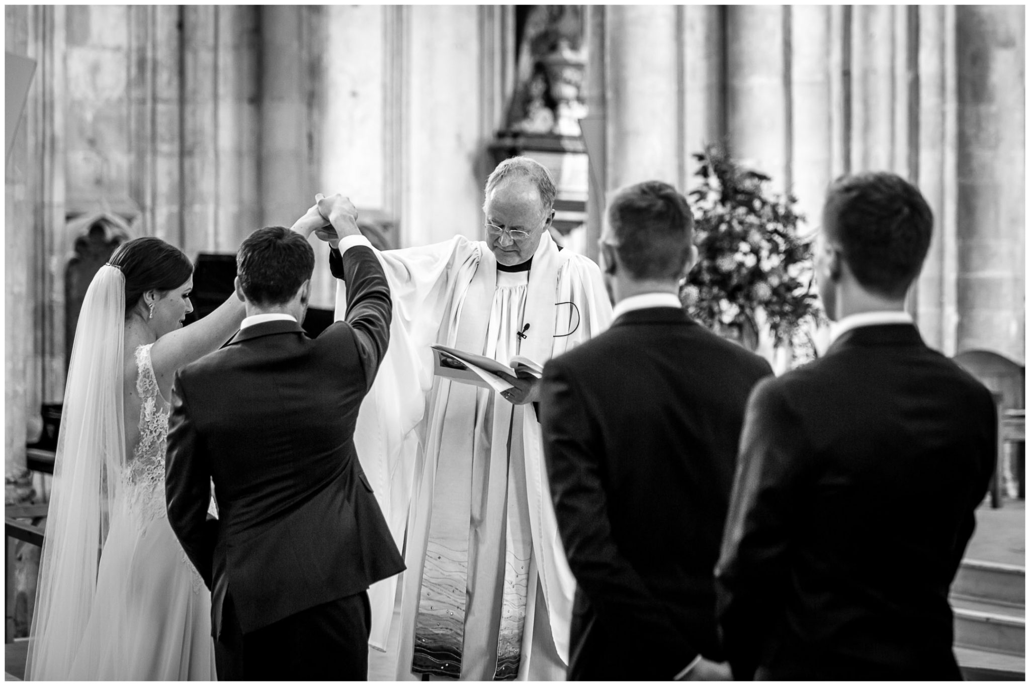 winchester cathedral wedding photography raising of hands to seal marriage