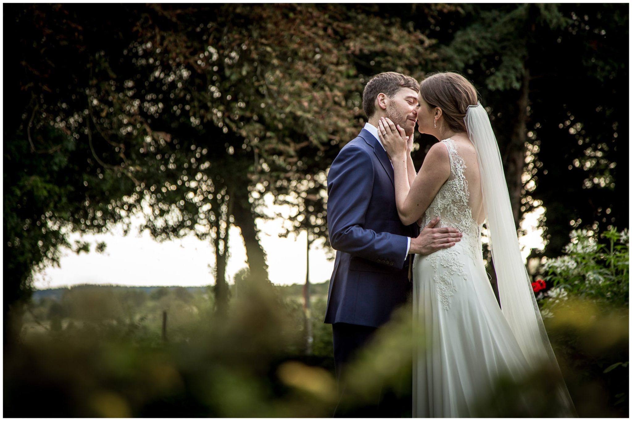 Old Alresford Place wedding photography couple kissing in gardens