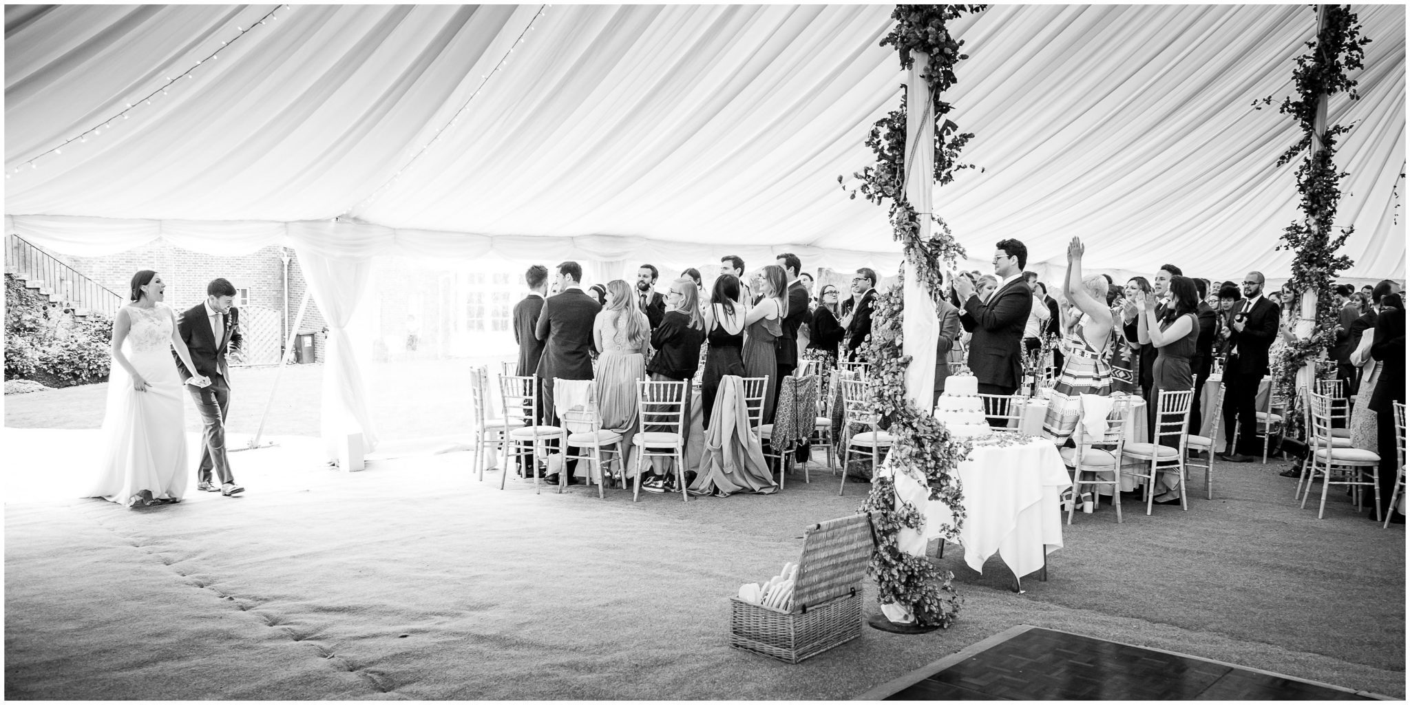 Old Alresford Place wedding photography couple enter marquee