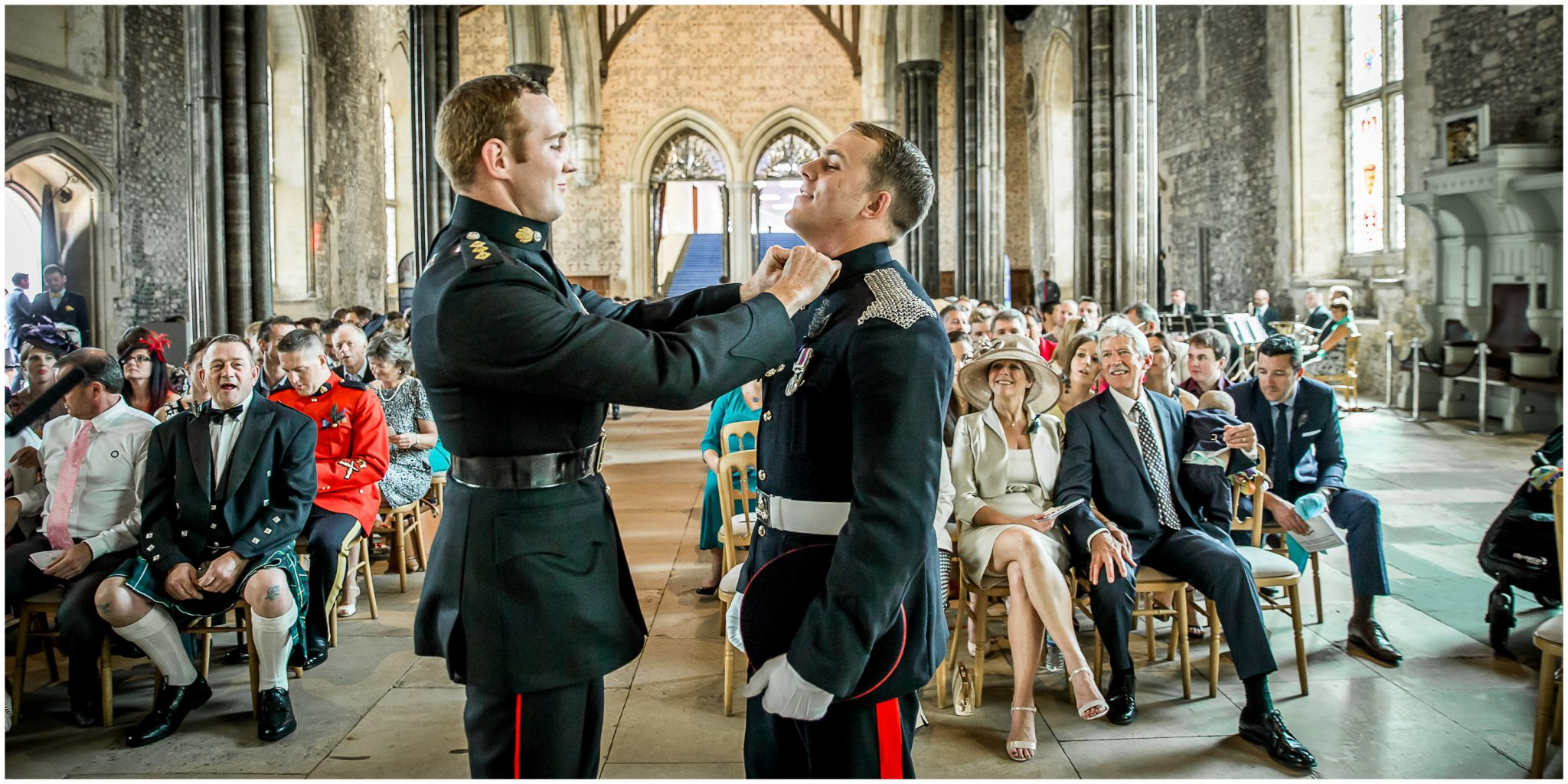 Winchester Great Hall wedding photography final touches for groom by best man