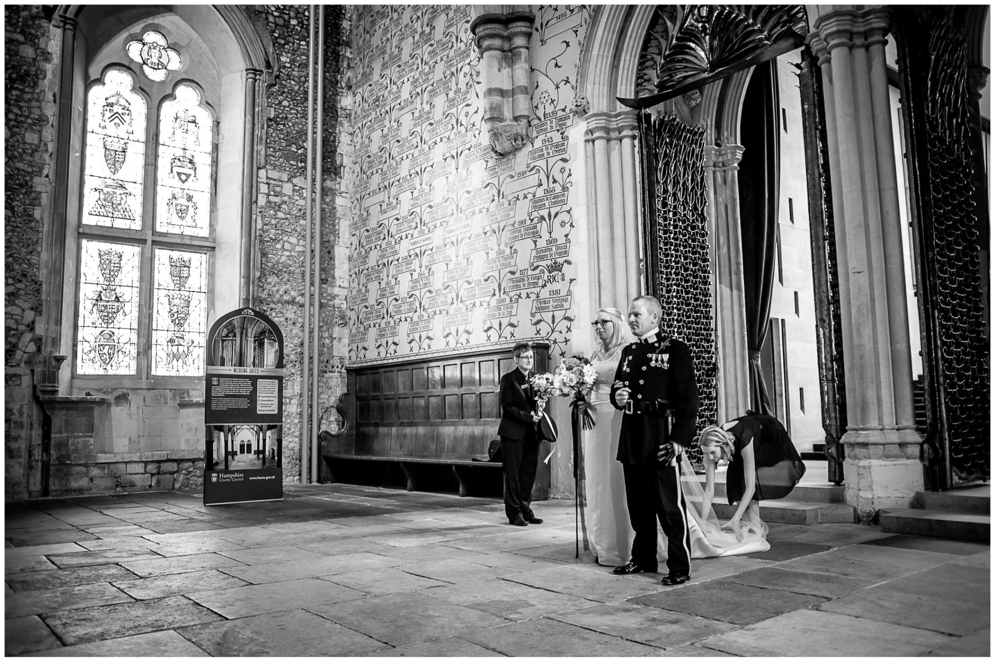 Winchester Great Hall wedding photography bride stood by iron gates before start of ceremony