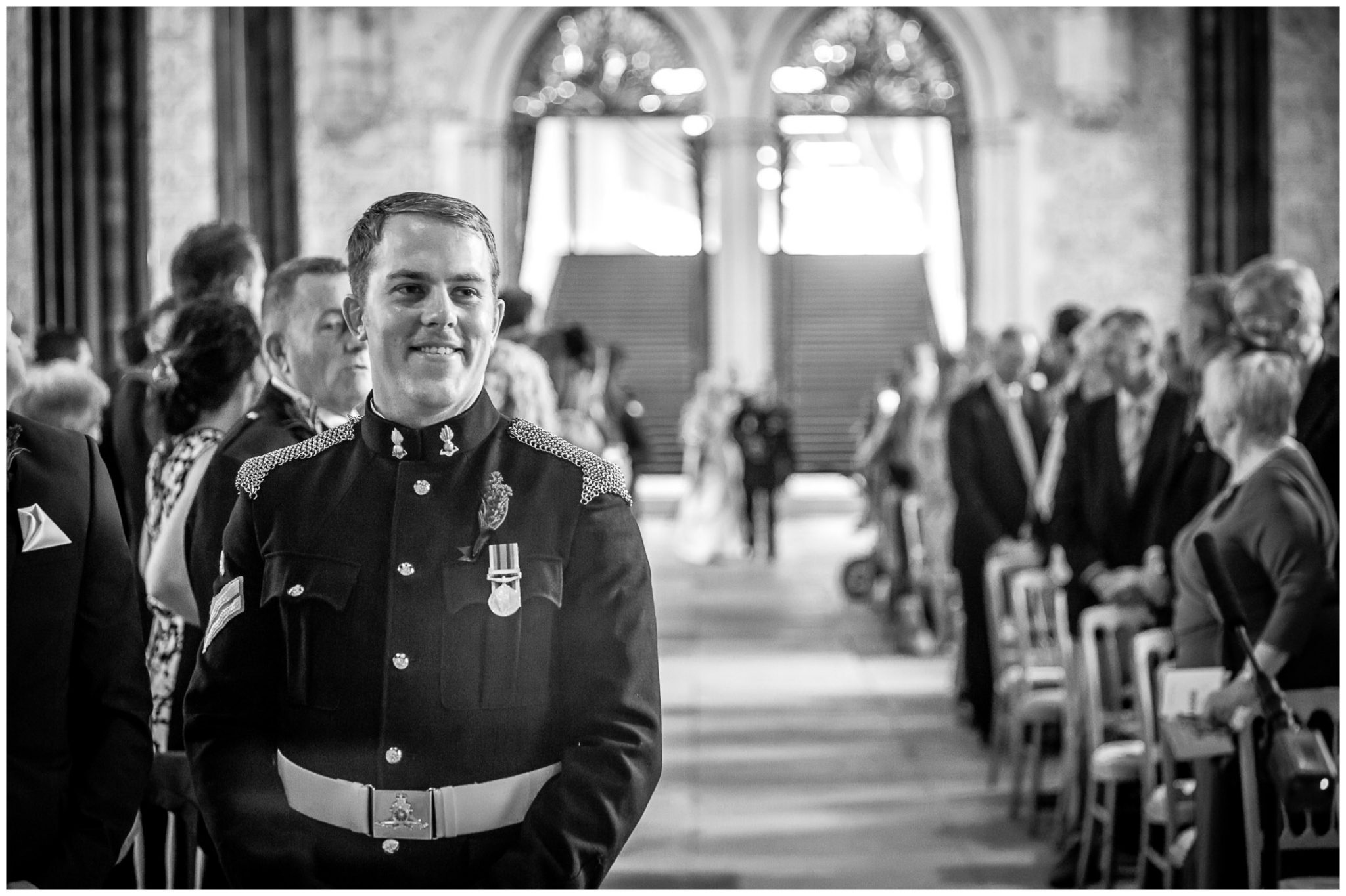 Winchester Great Hall wedding photography groom waits for bride at the end of the aisle