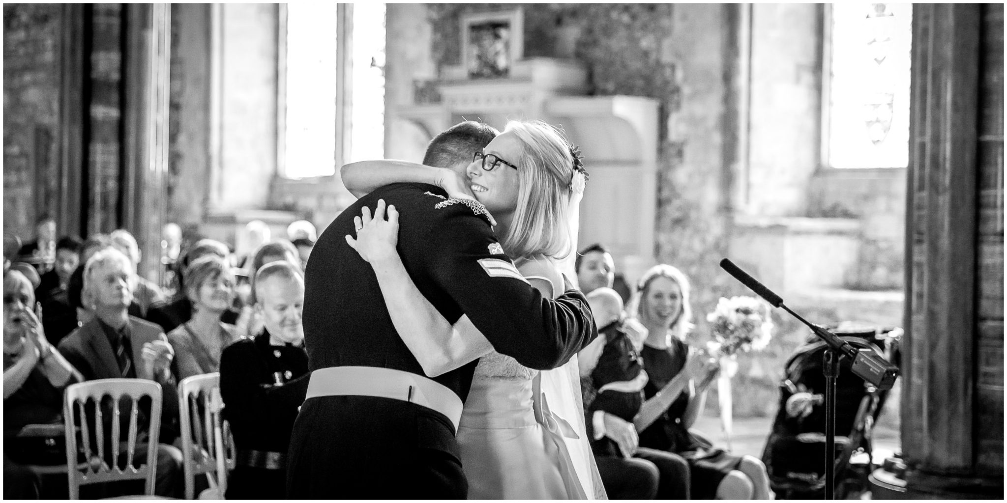 Winchester Great Hall wedding photography bride hugs groom black and white