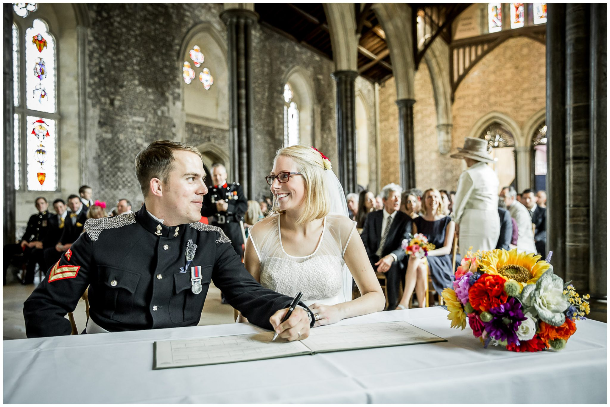Winchester Great Hall wedding photography bride and groom sign register