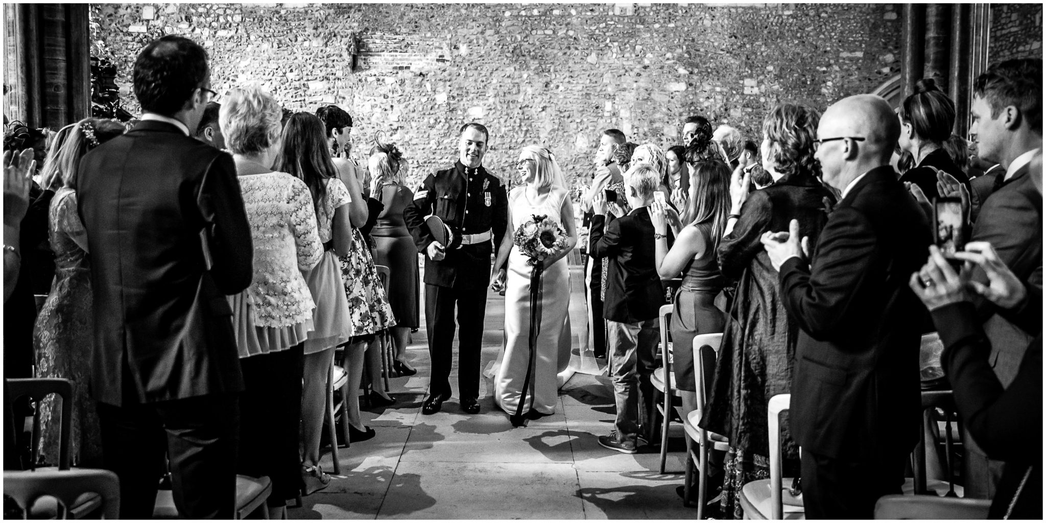 Winchester Great Hall wedding photography couple walk together down the aisle