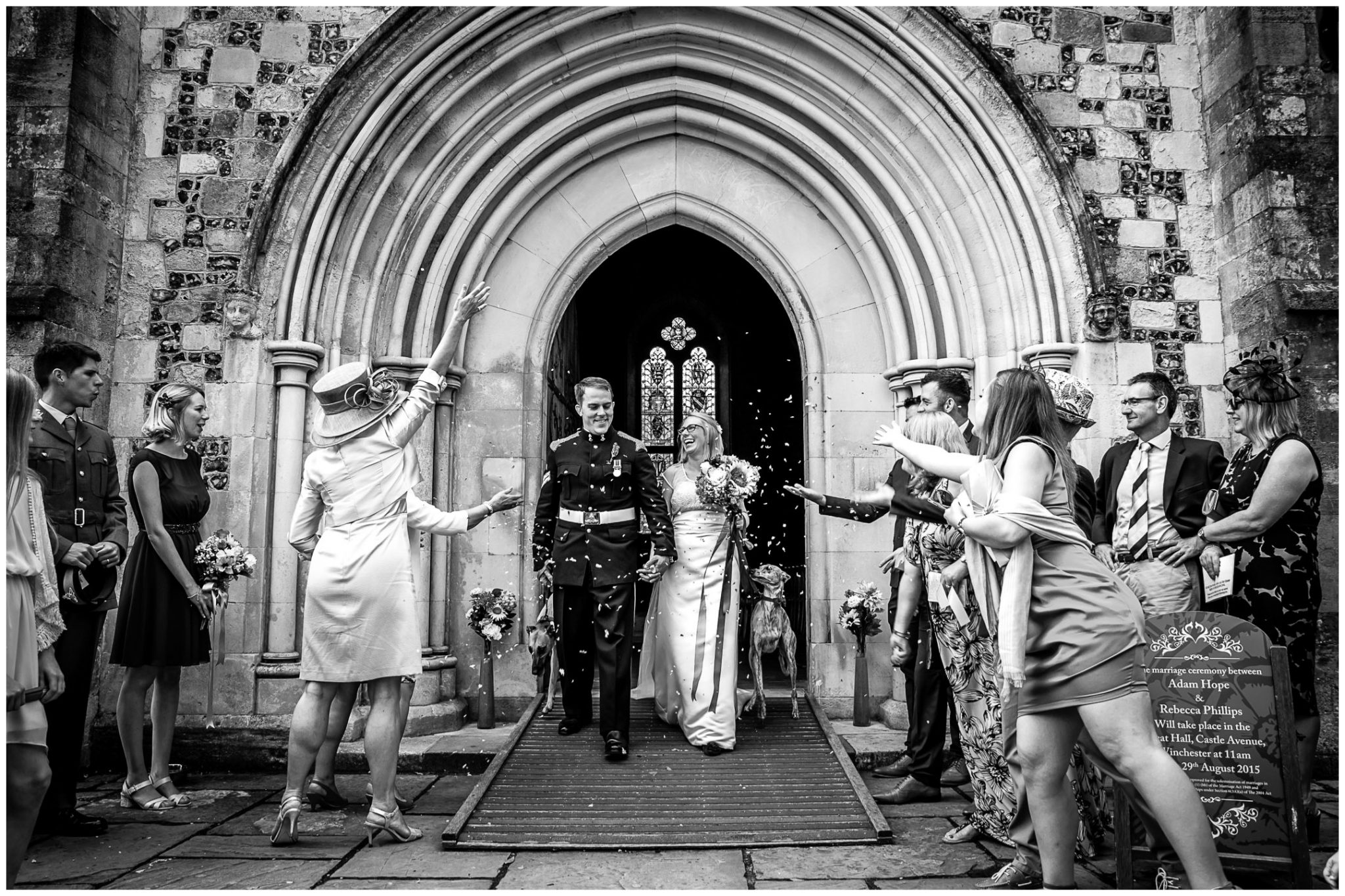 Winchester Great Hall wedding photography couple exit venue to confetti