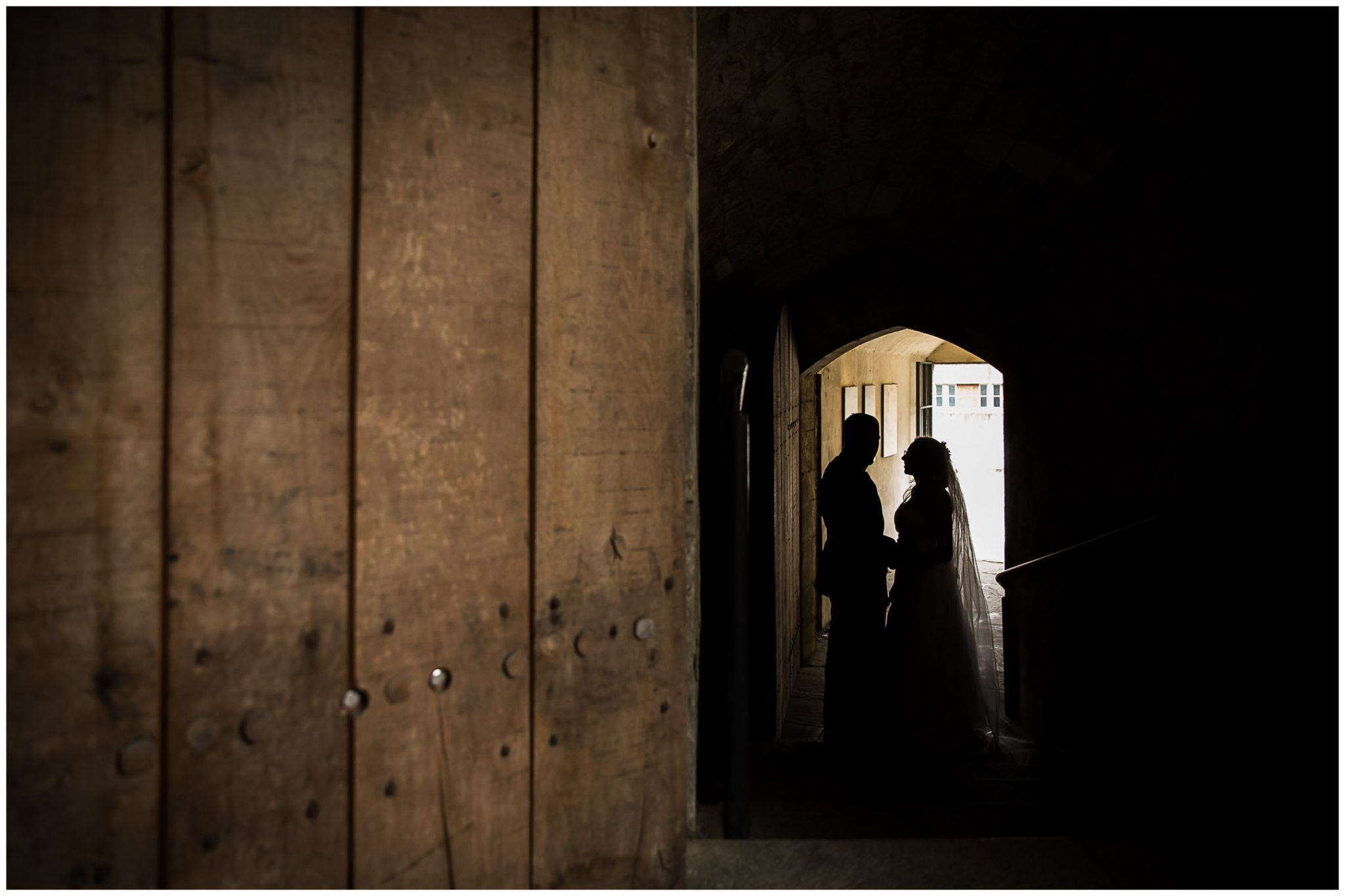 Winchester Great Hall wedding photography couple silhouette in castle tunnels