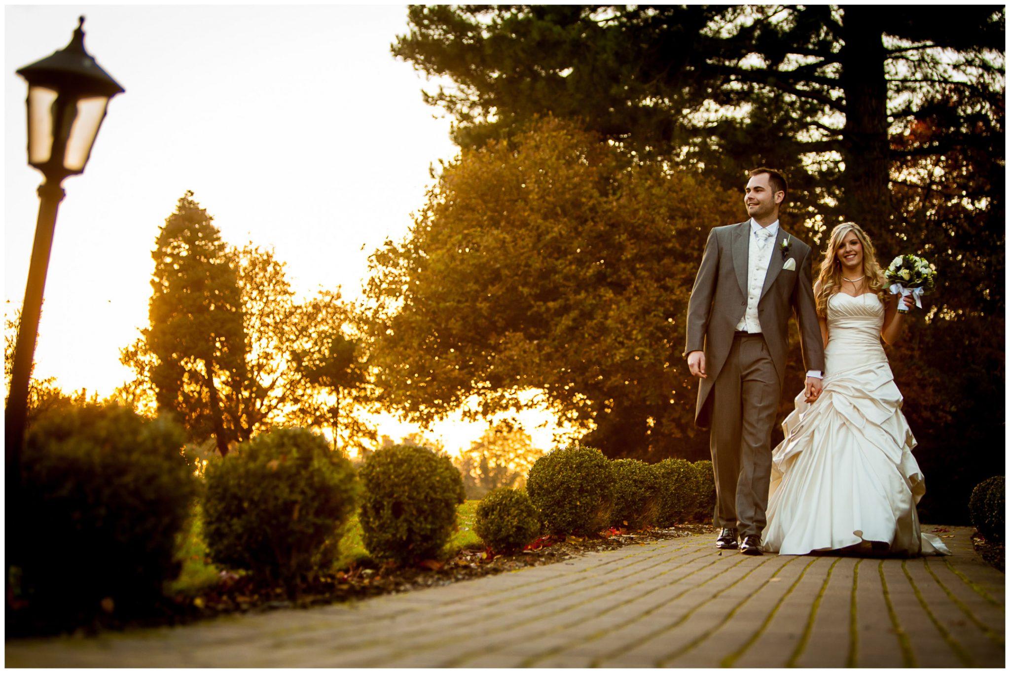 Audleys Wood wedding photography couple walking in evening sunshine