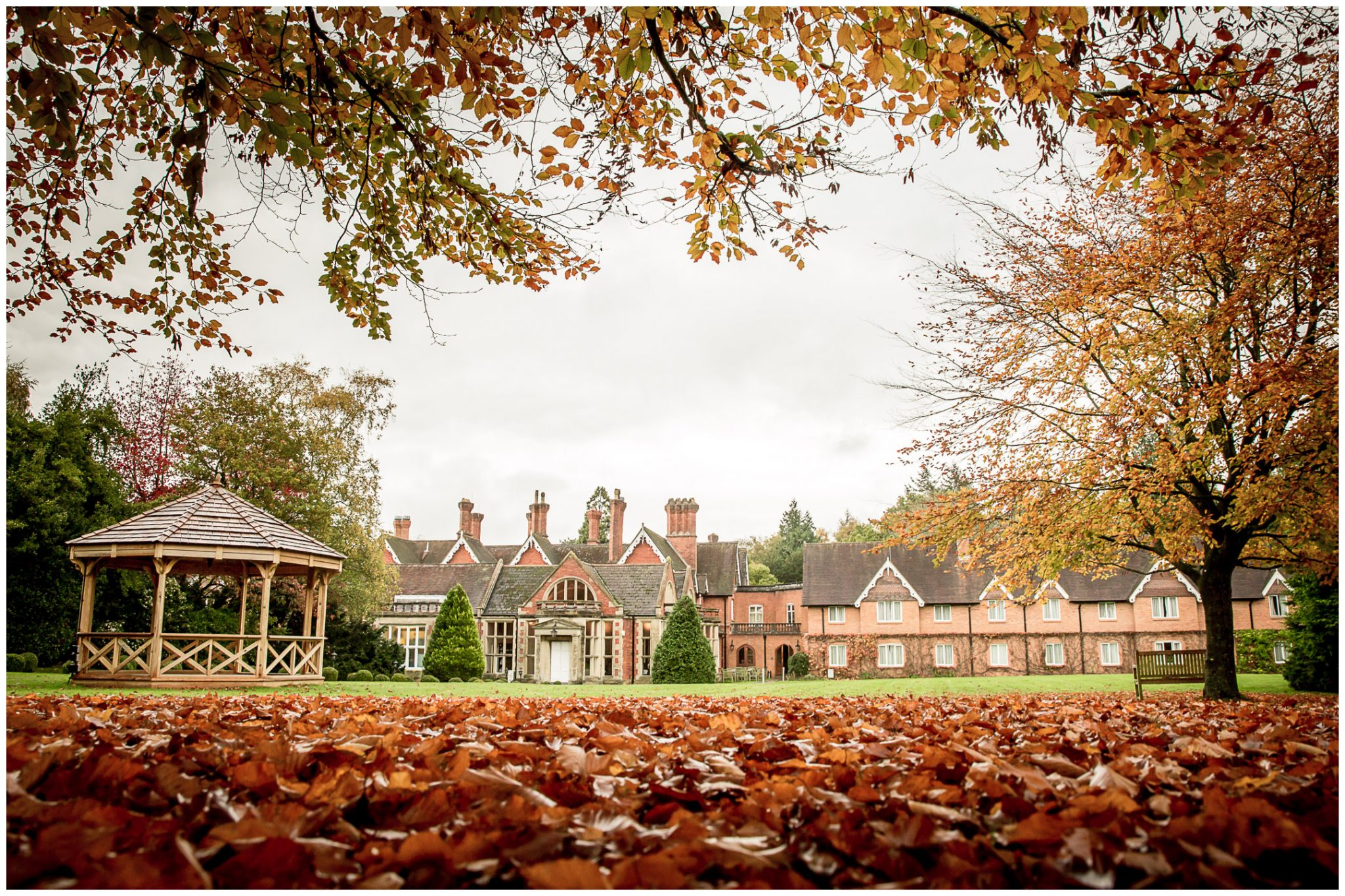 Audleys Wood wedding photograhy venue exterior with autumn colours in the trees