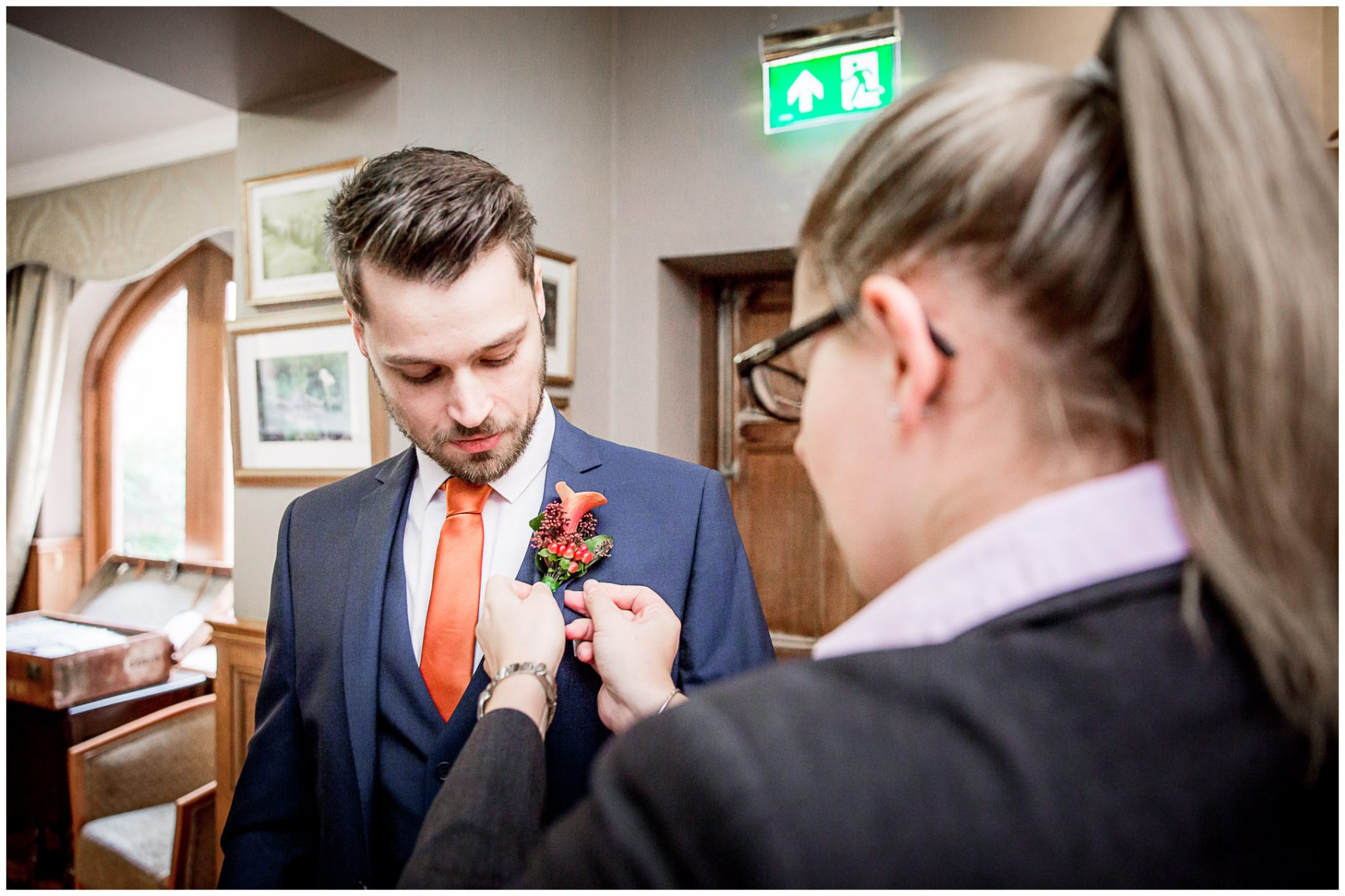 Audleys Wood wedding photograhy groom putting on buttonhole