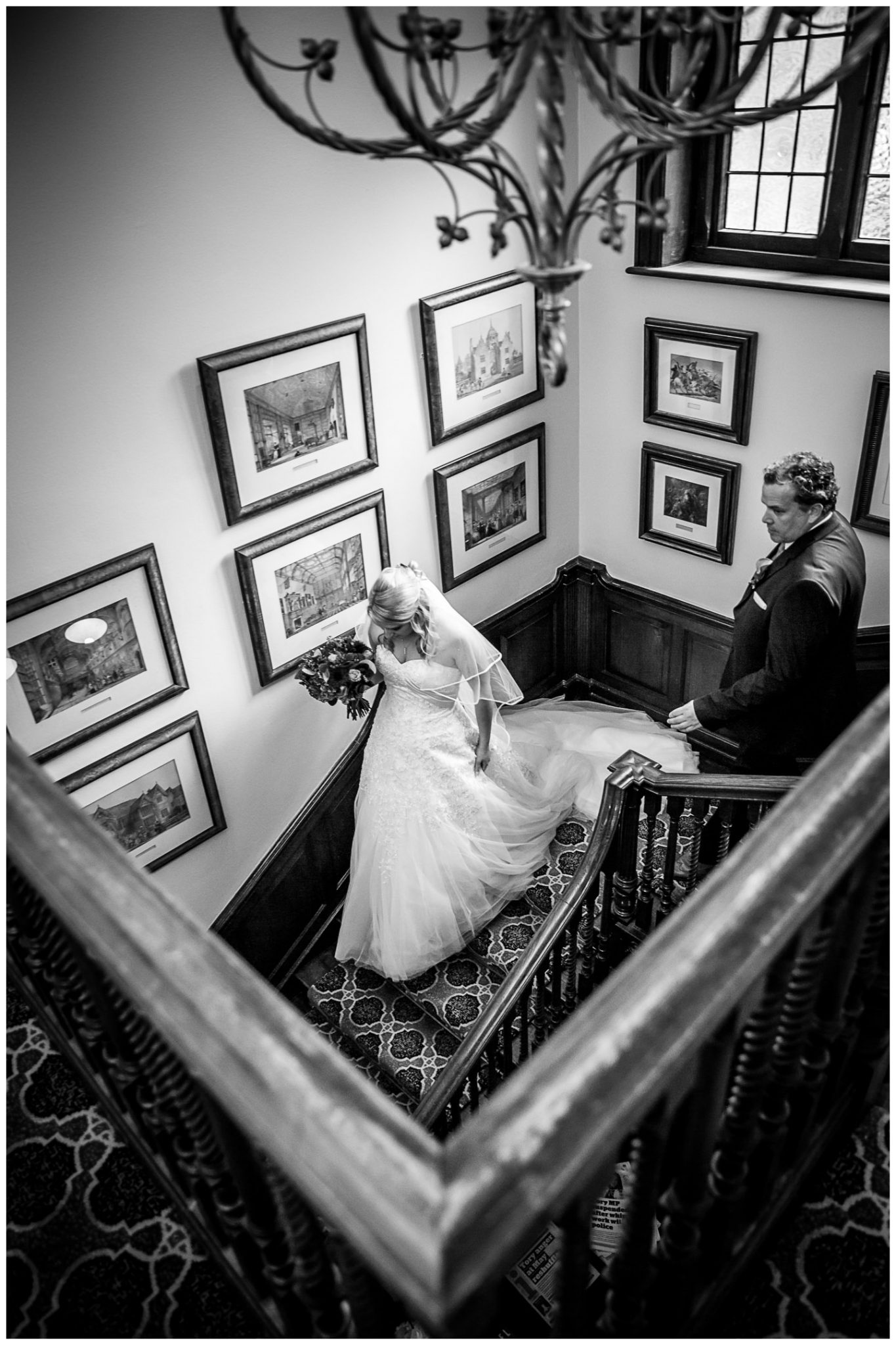 Audleys Wood wedding photograhy bride walks down staircase to ceremony room