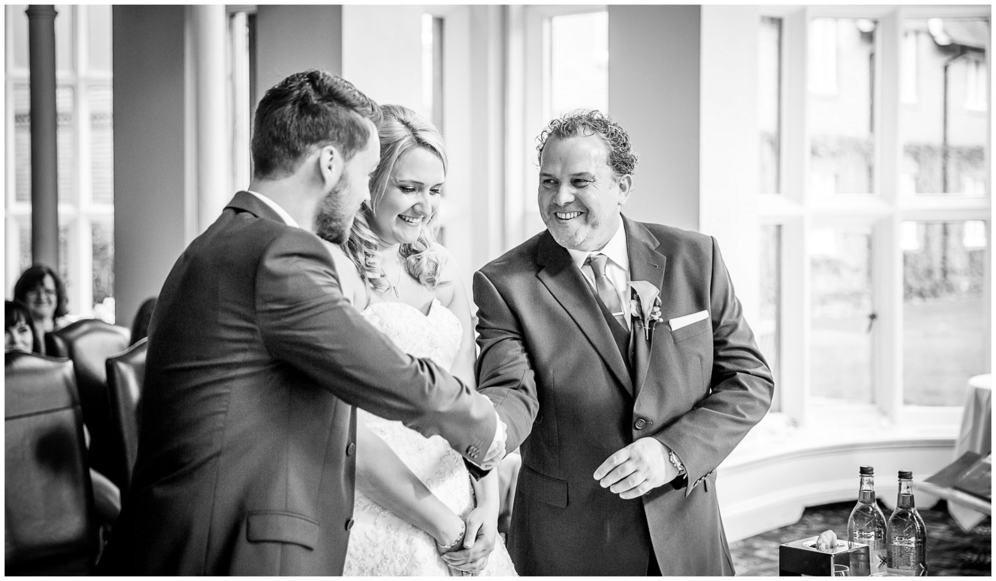 Audleys Wood wedding photograhy groom shakes father of the bride's hand