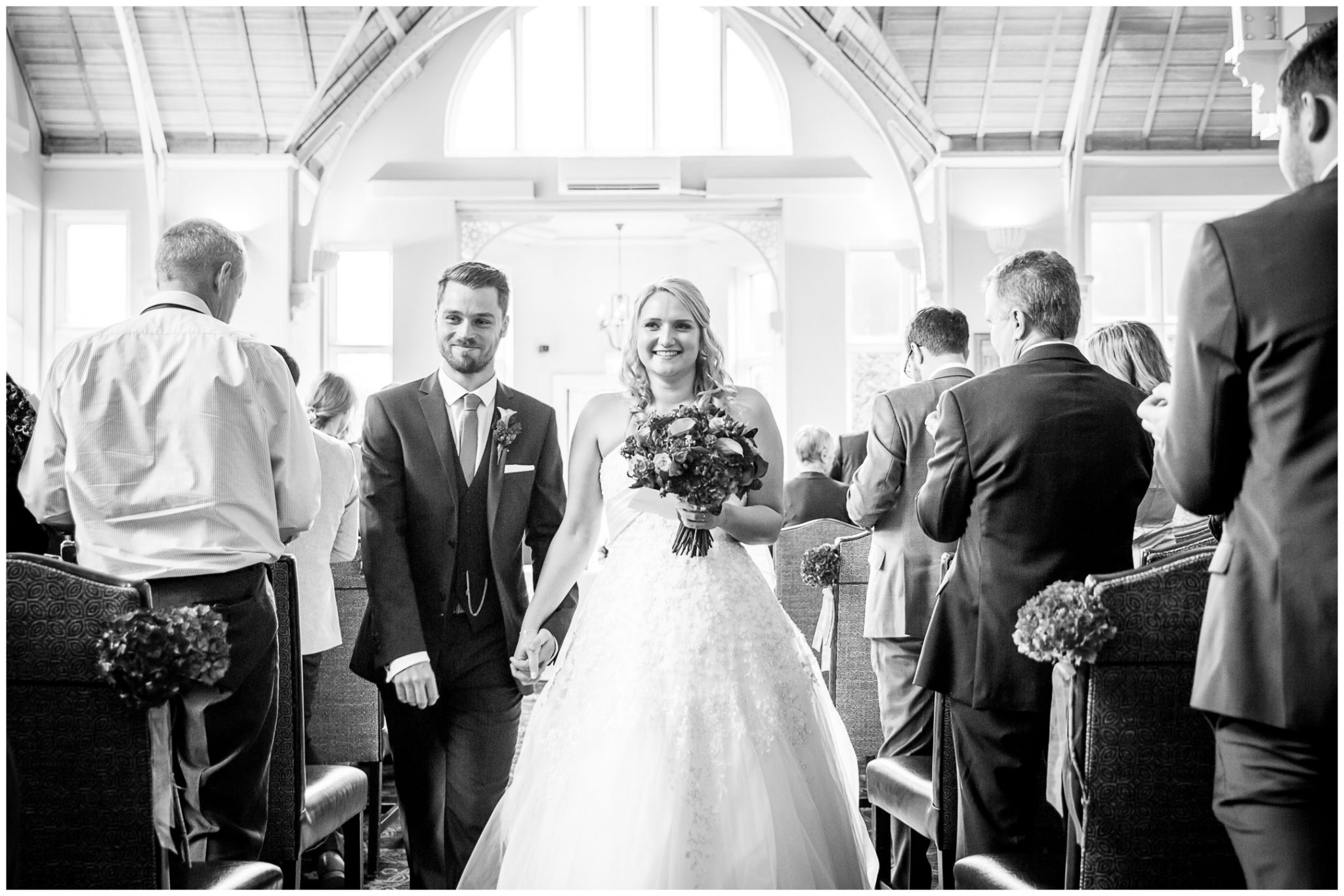 Audleys Wood wedding photograhy couple walk down aisle