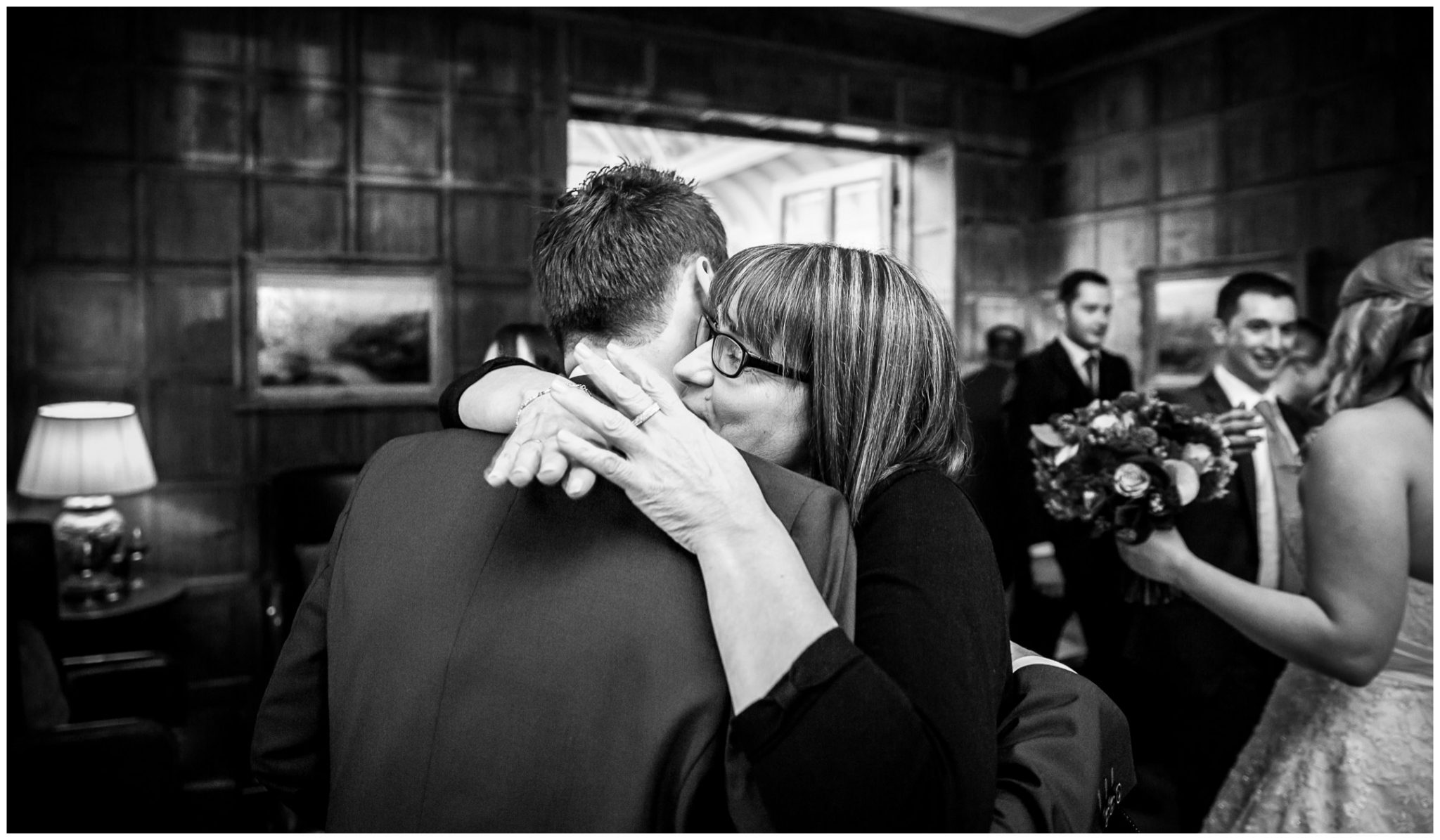 Audleys Wood wedding photograhy kisses and hugs after marriage service