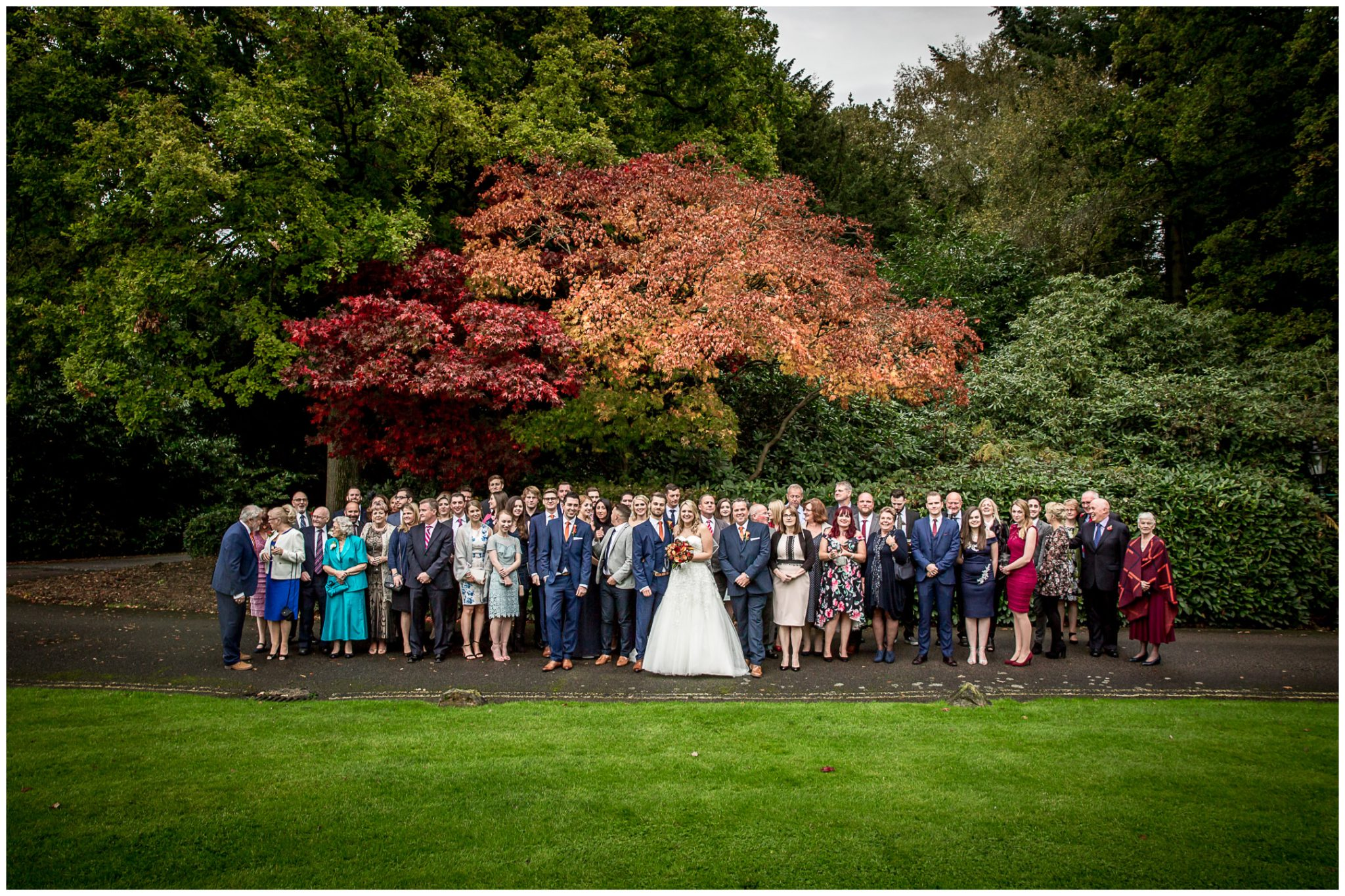 Audleys Wood wedding photograhy group photo by front lawn