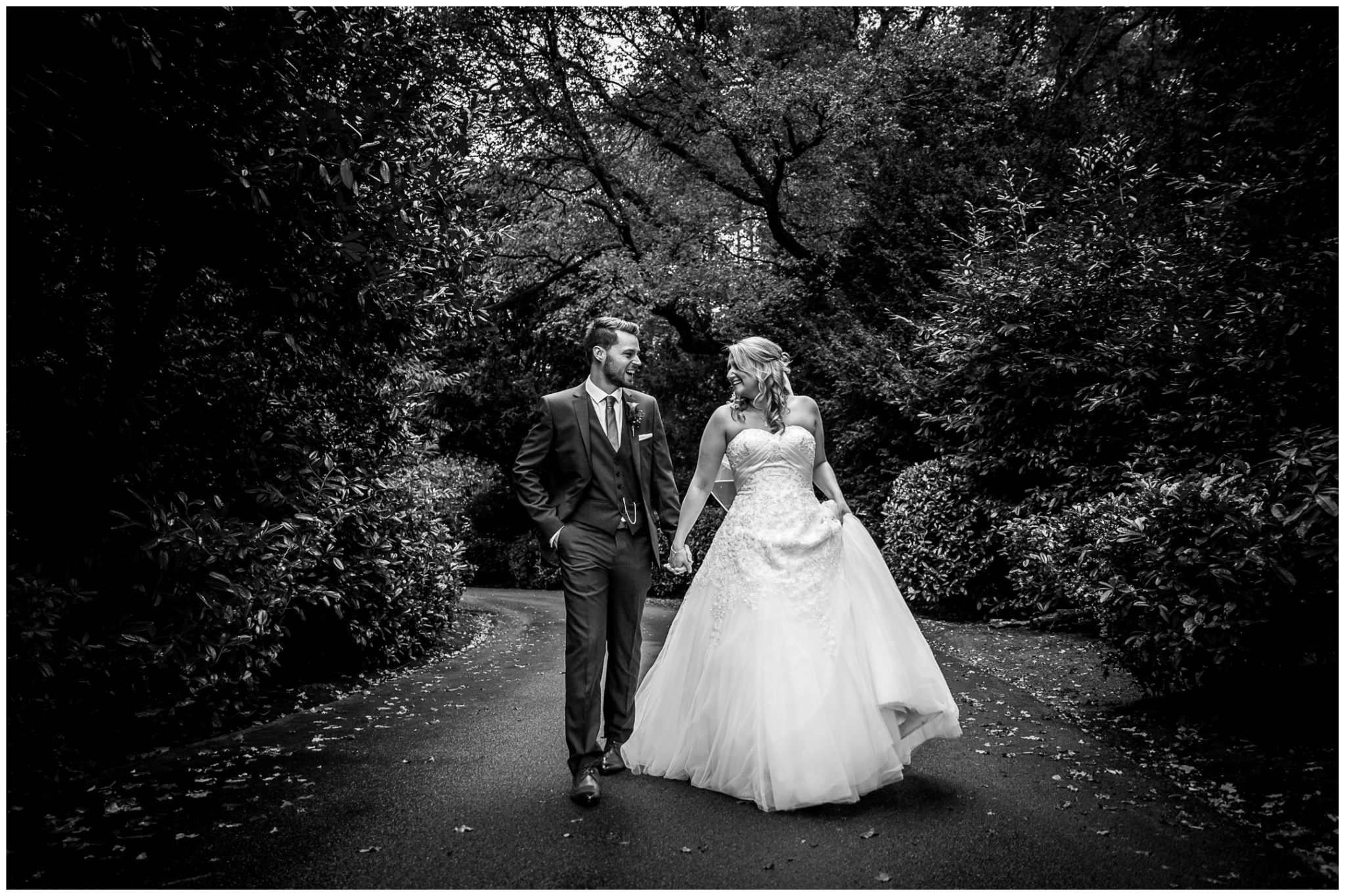 Audleys Wood wedding photograhy black and white photo of couple walking along drive