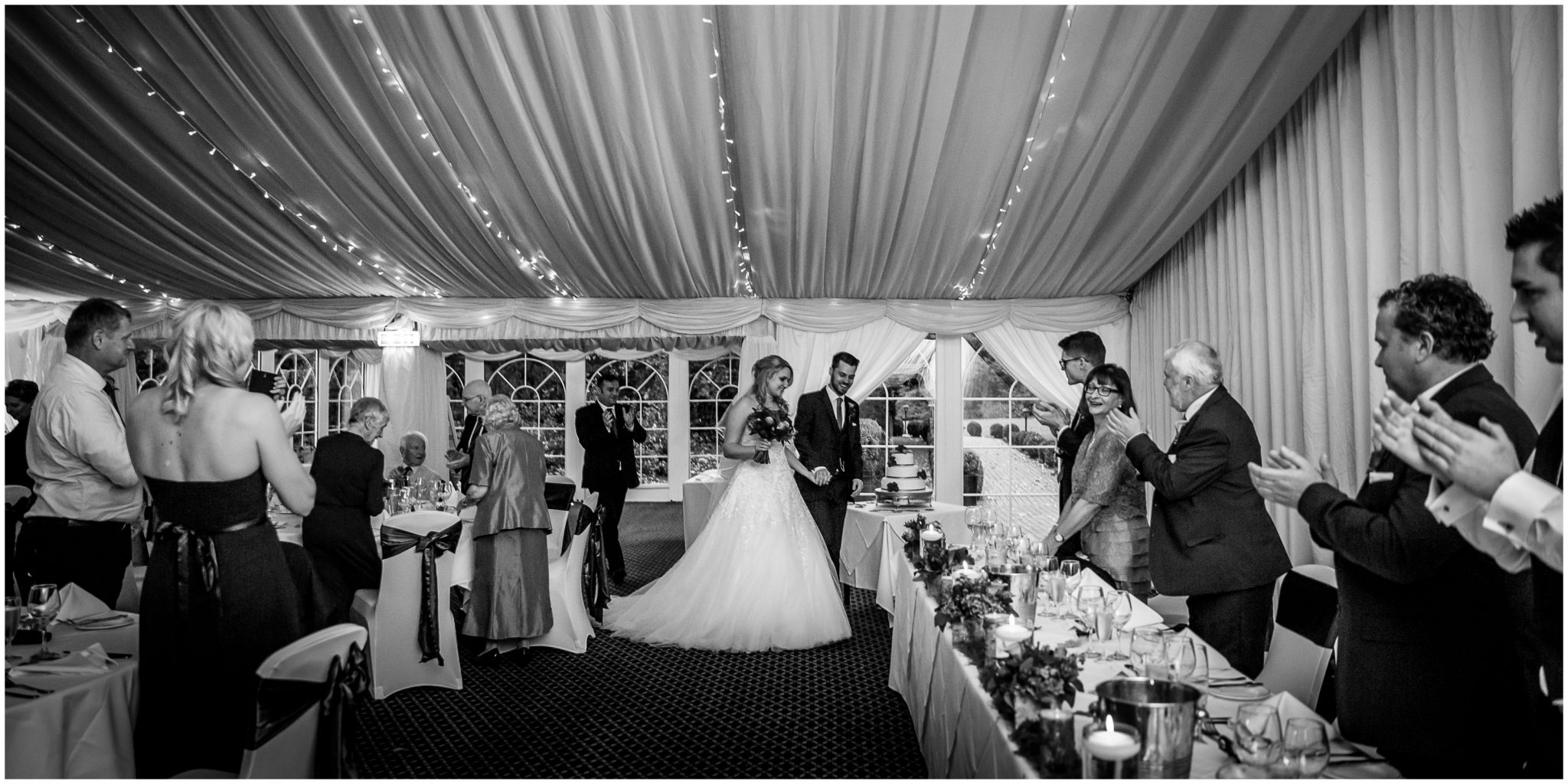 Audleys Wood wedding photograhy bride and groom walk into reception marquee