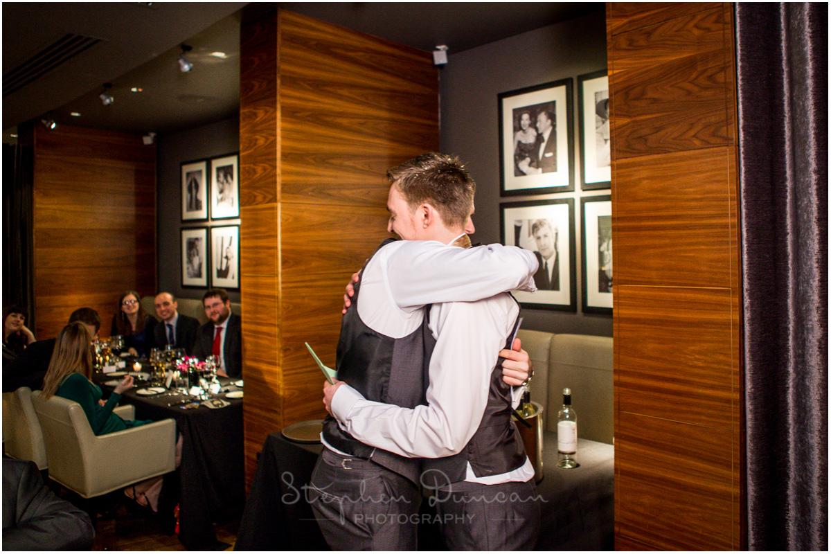 The Aviator wedding photography groom hugs best man