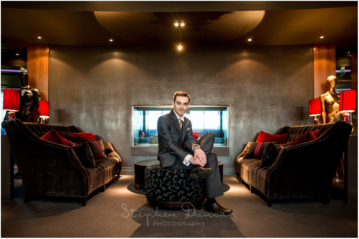 The Aviator wedding photography groom portrait in lobby