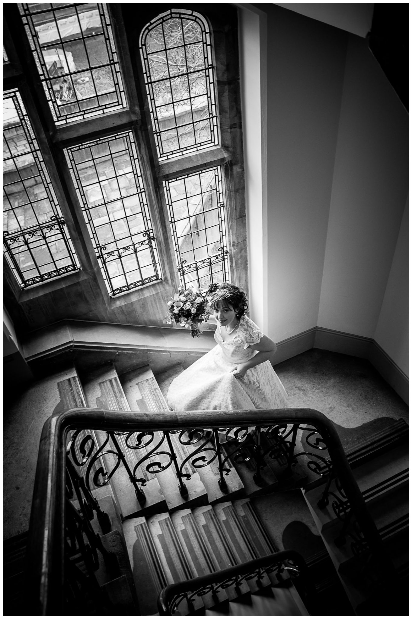Castle Room Winchester wedding photography bride walks up stair case