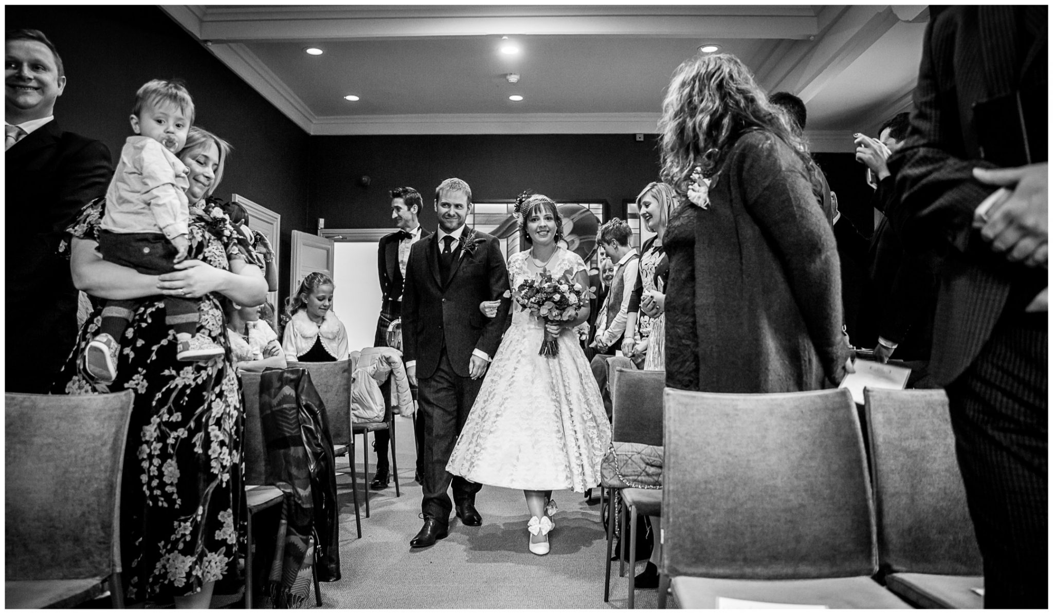 Castle Room Winchester wedding photography bride and groomwalk down the aisle