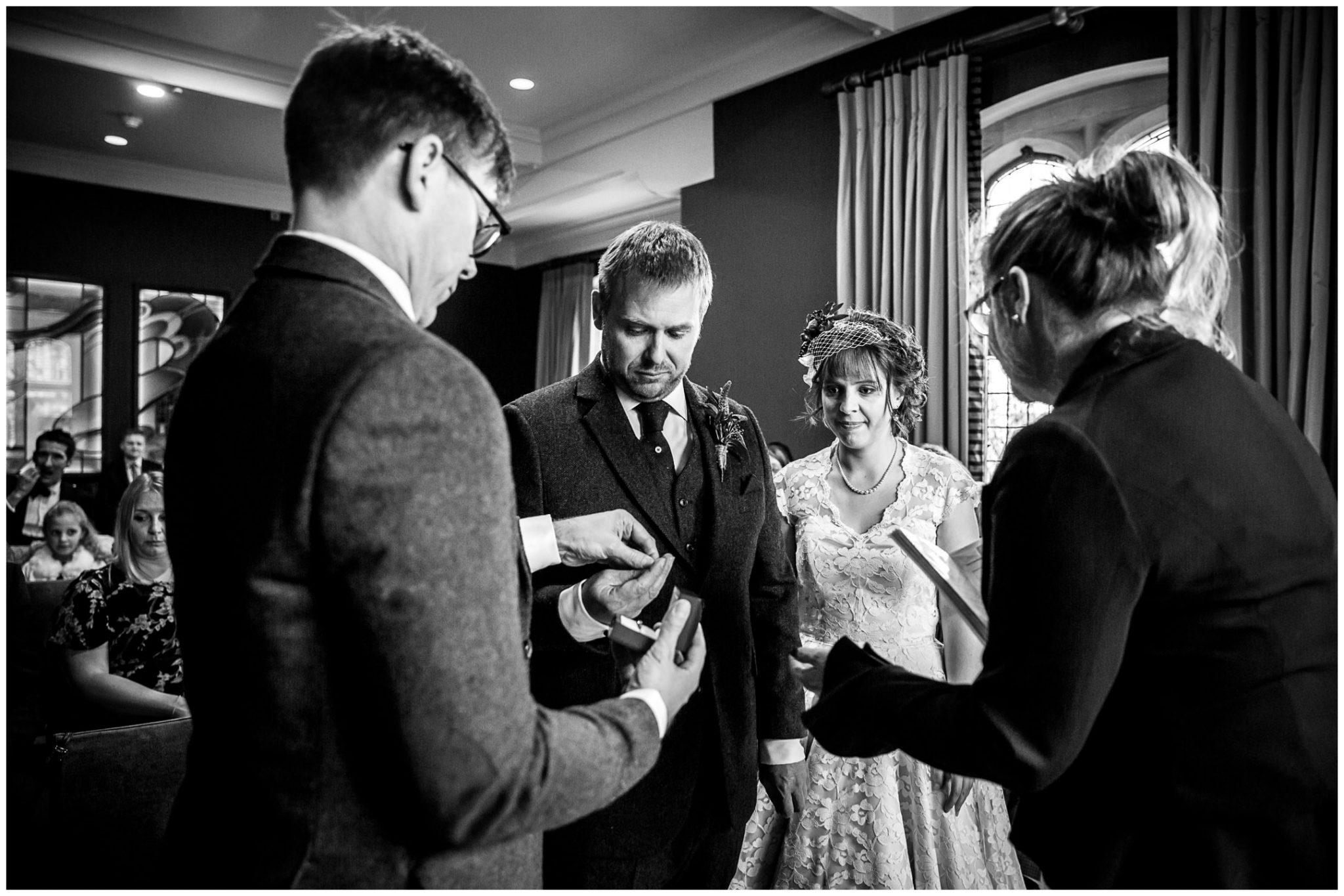 Castle Room Winchester wedding photography groom takes ring from best man