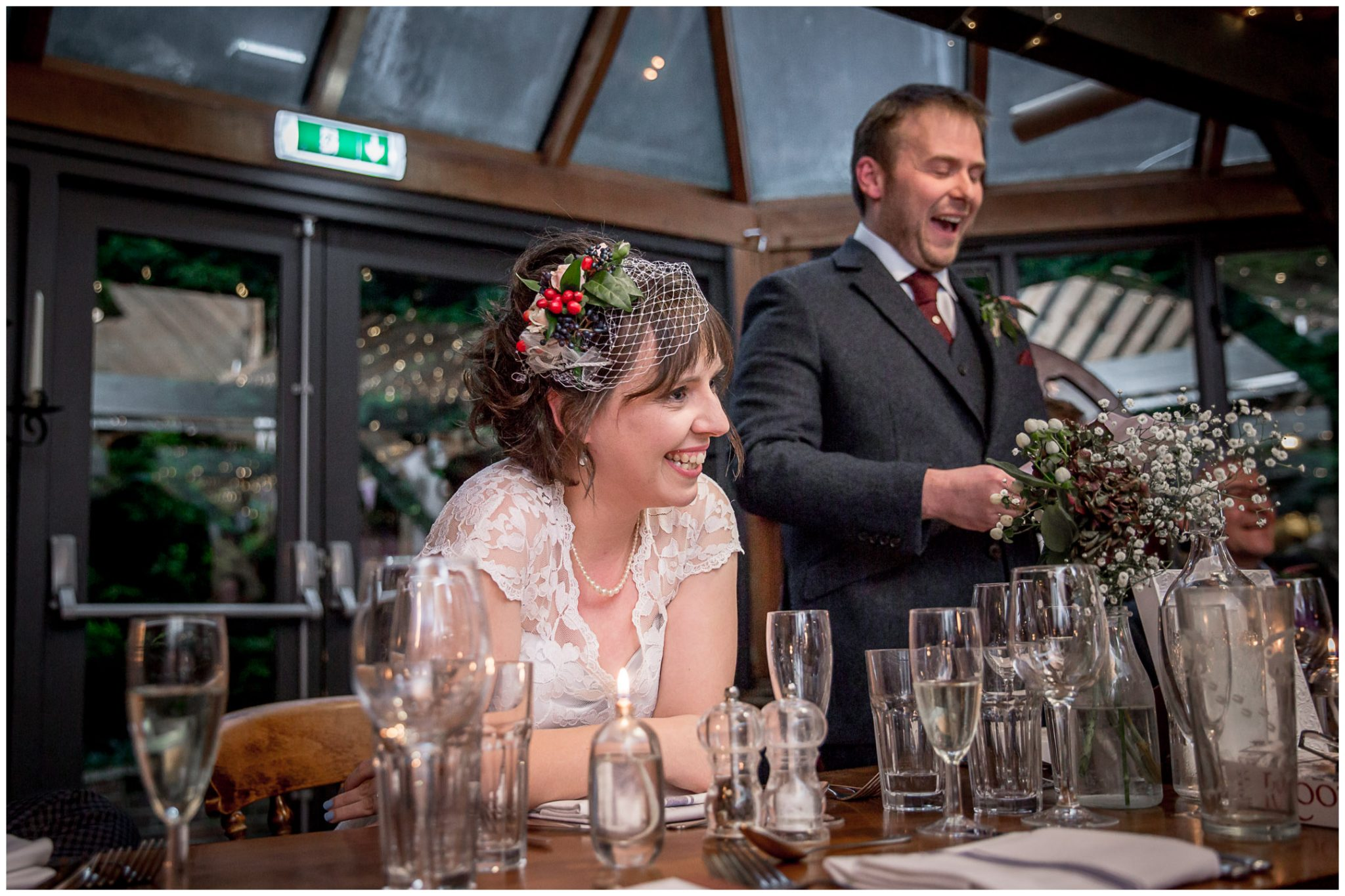 Castle Room Winchester wedding photography bride laughing during speeches