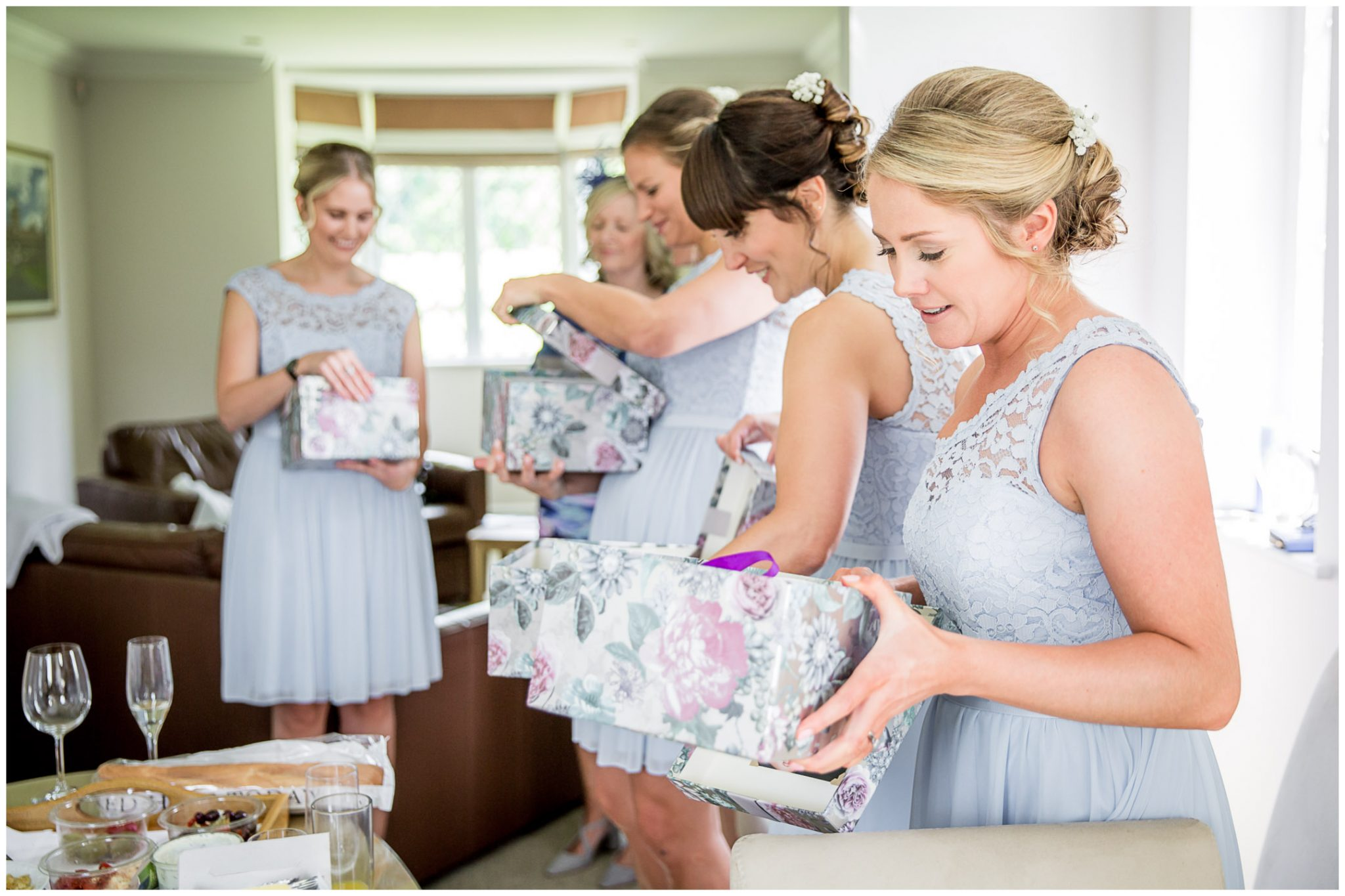 Oakley Hall wedding photography bridesmaids receiving gifts