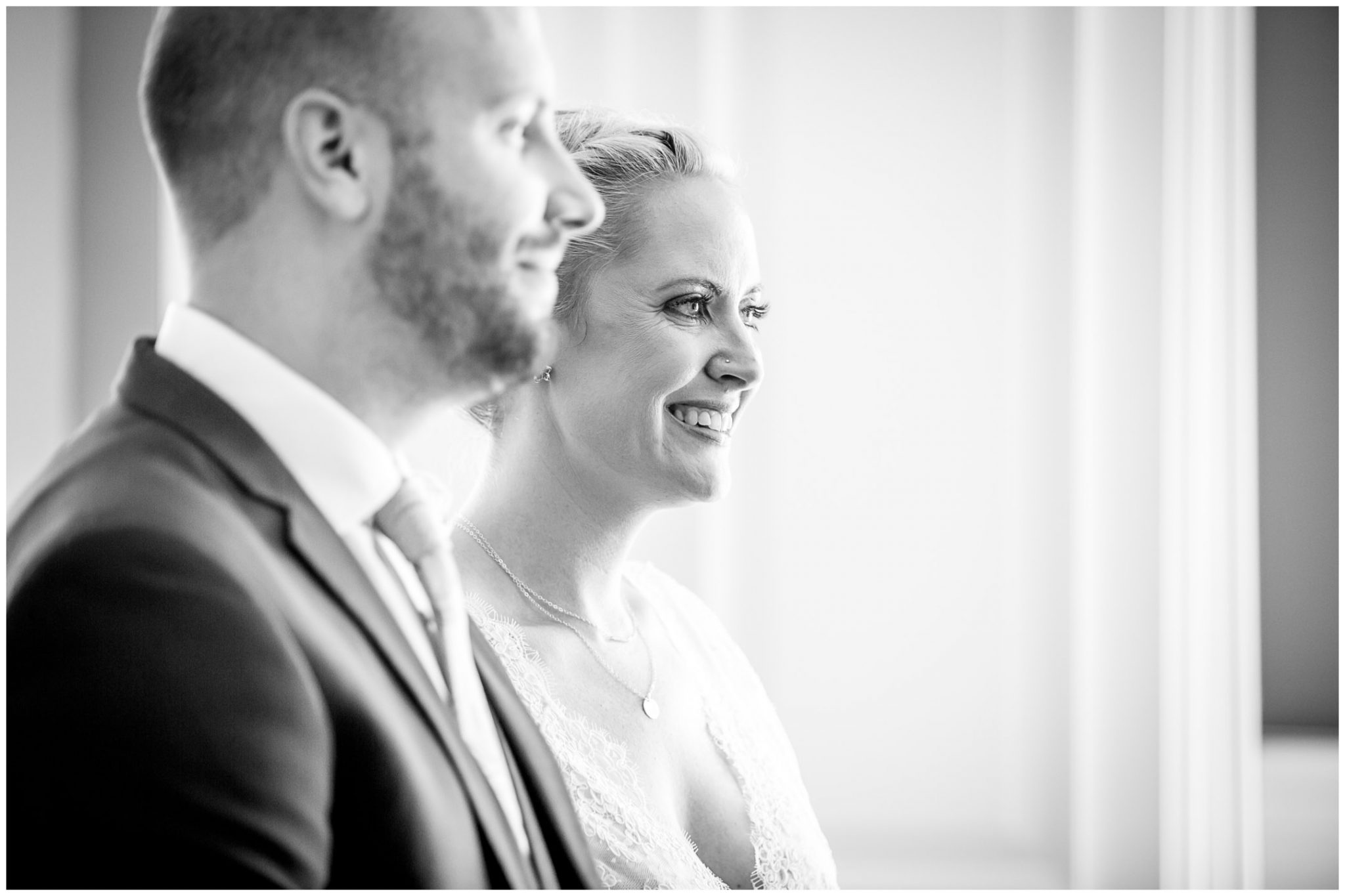 Oakley Hall wedding photography bride smiling during marriage ceremony