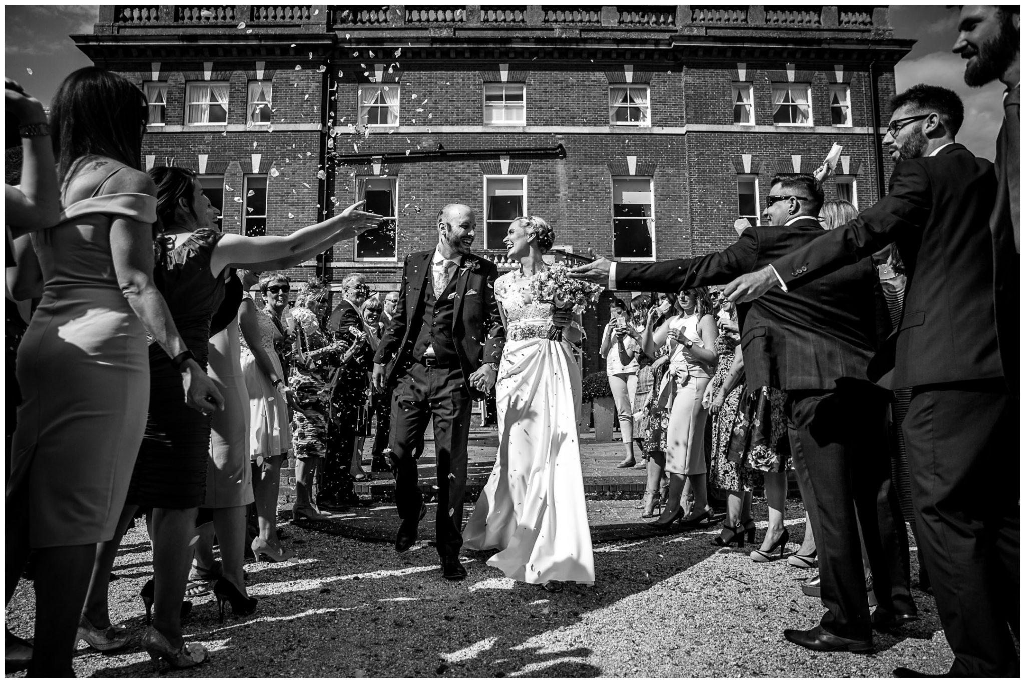 Oakley Hall wedding photography confetti on terrace