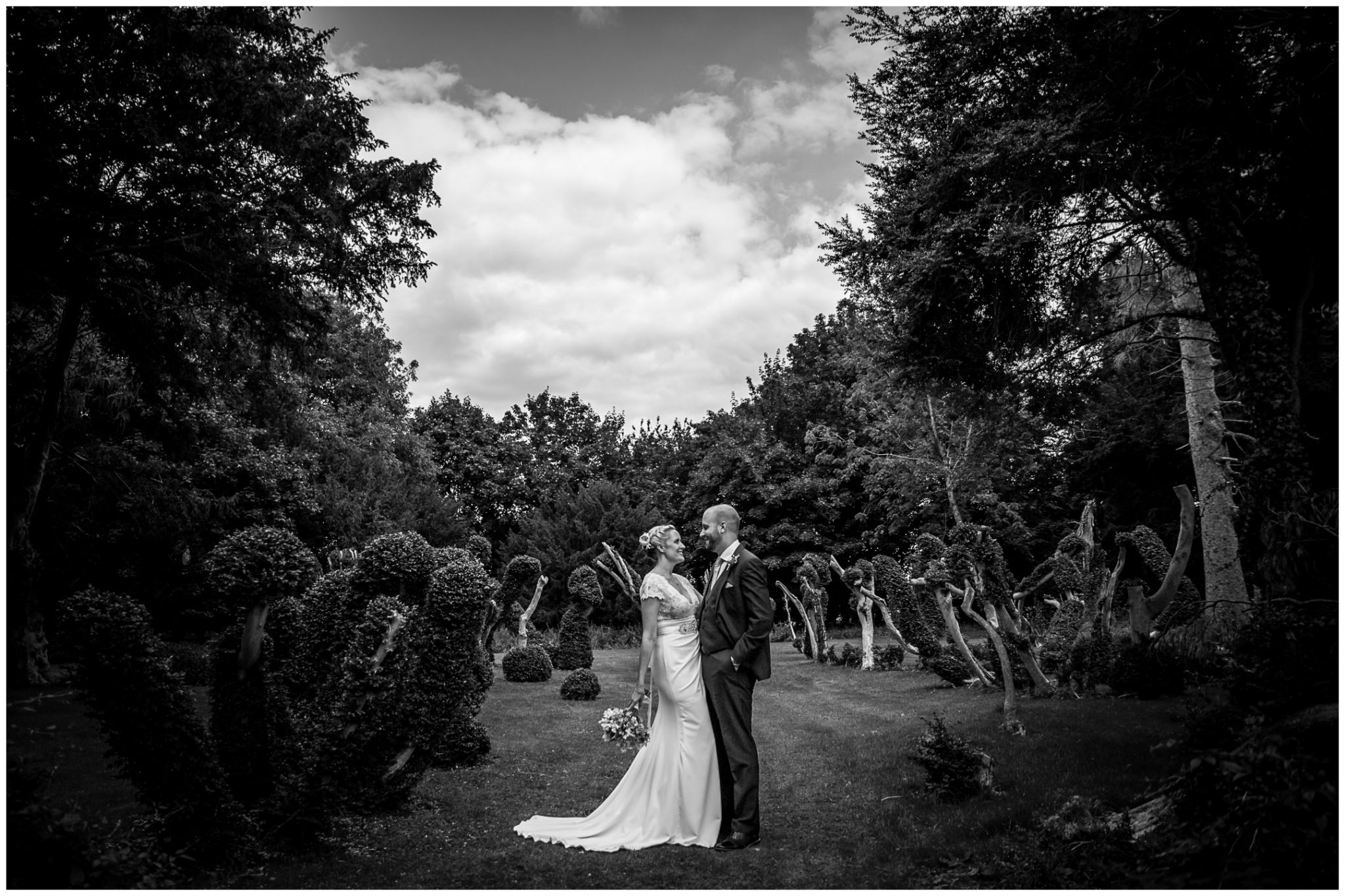 Oakley Hall wedding photography couple portrait in gardens
