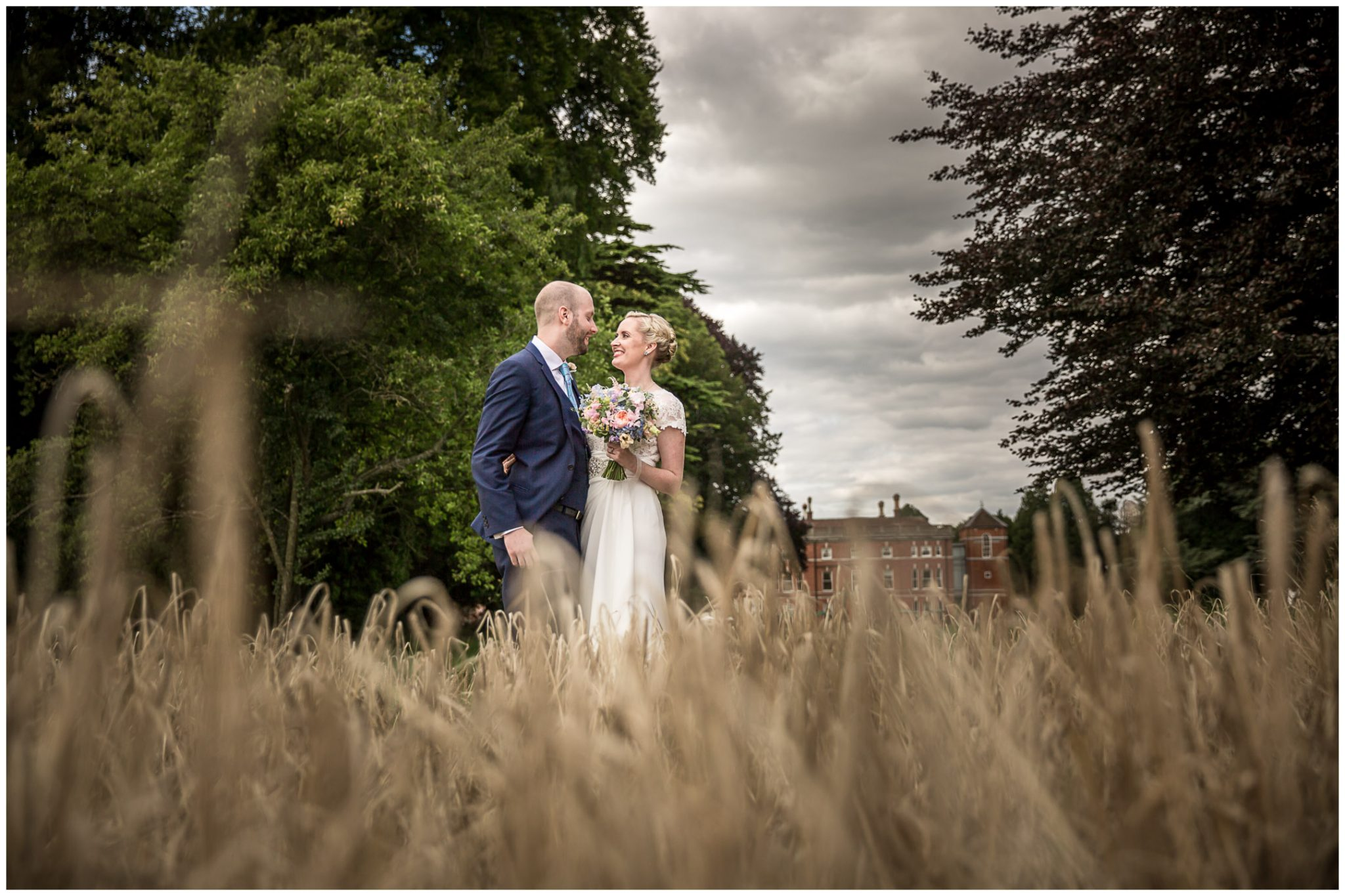 Oakley Hall wedding photography bride and groom portrait in grounds