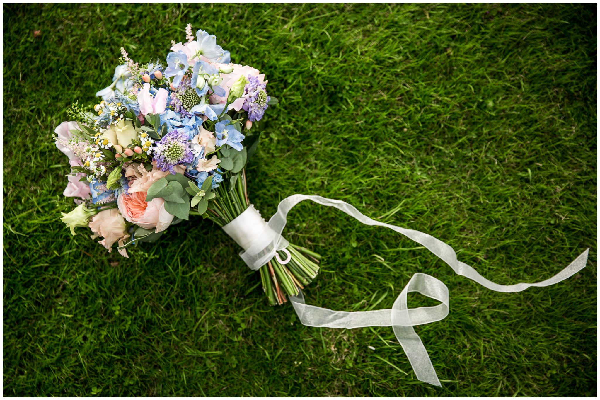 Oakley Hall wedding photography bouquet on lawn