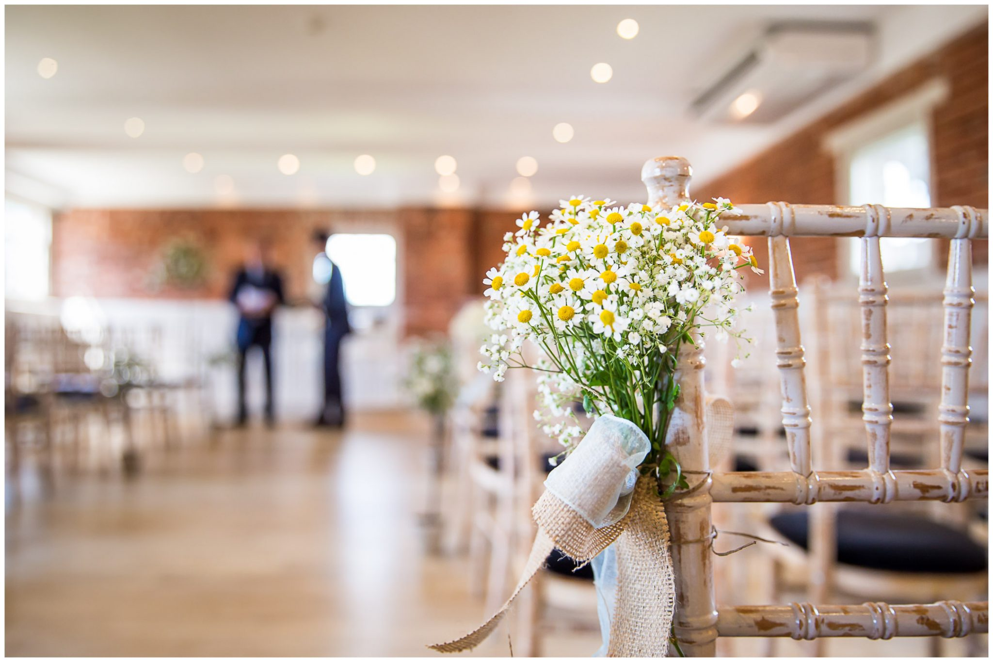 Sopley Mill Summer wedding chair decorations in ceremony room